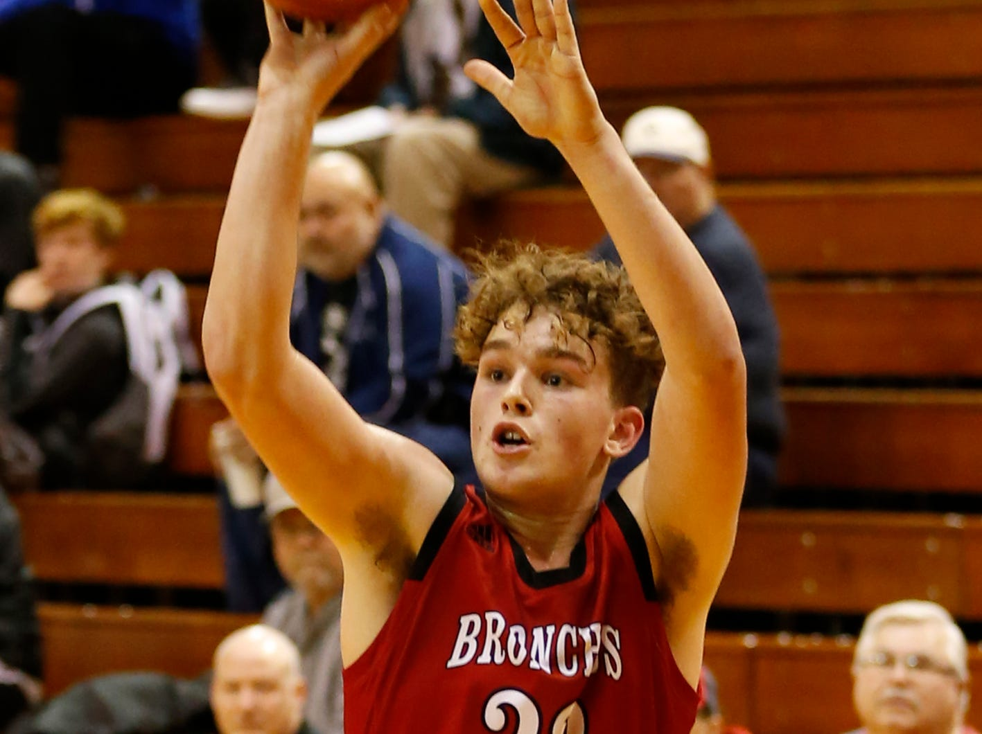 Ashton Beaver of Lafayette Jeff with a three-point shot against Central Catholic in the championship of the Franciscan Health Hoops Classic Saturday, December 1, 2018, at Lafayette Jeff. Jeff defeated Central Catholic 76-73 for the title.