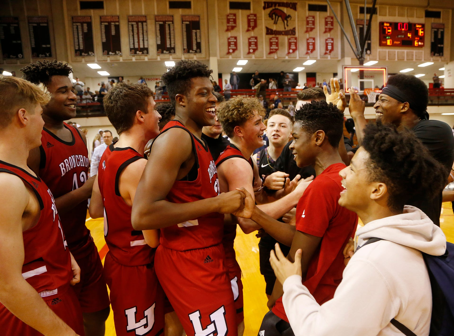 Lafayette Jeff players and classmates celebrate after defeating Central Catholic 76-73 in the championship of the Franciscan Health Hoops Classic Saturday, December 1, 2018, at Lafayette Jeff.
