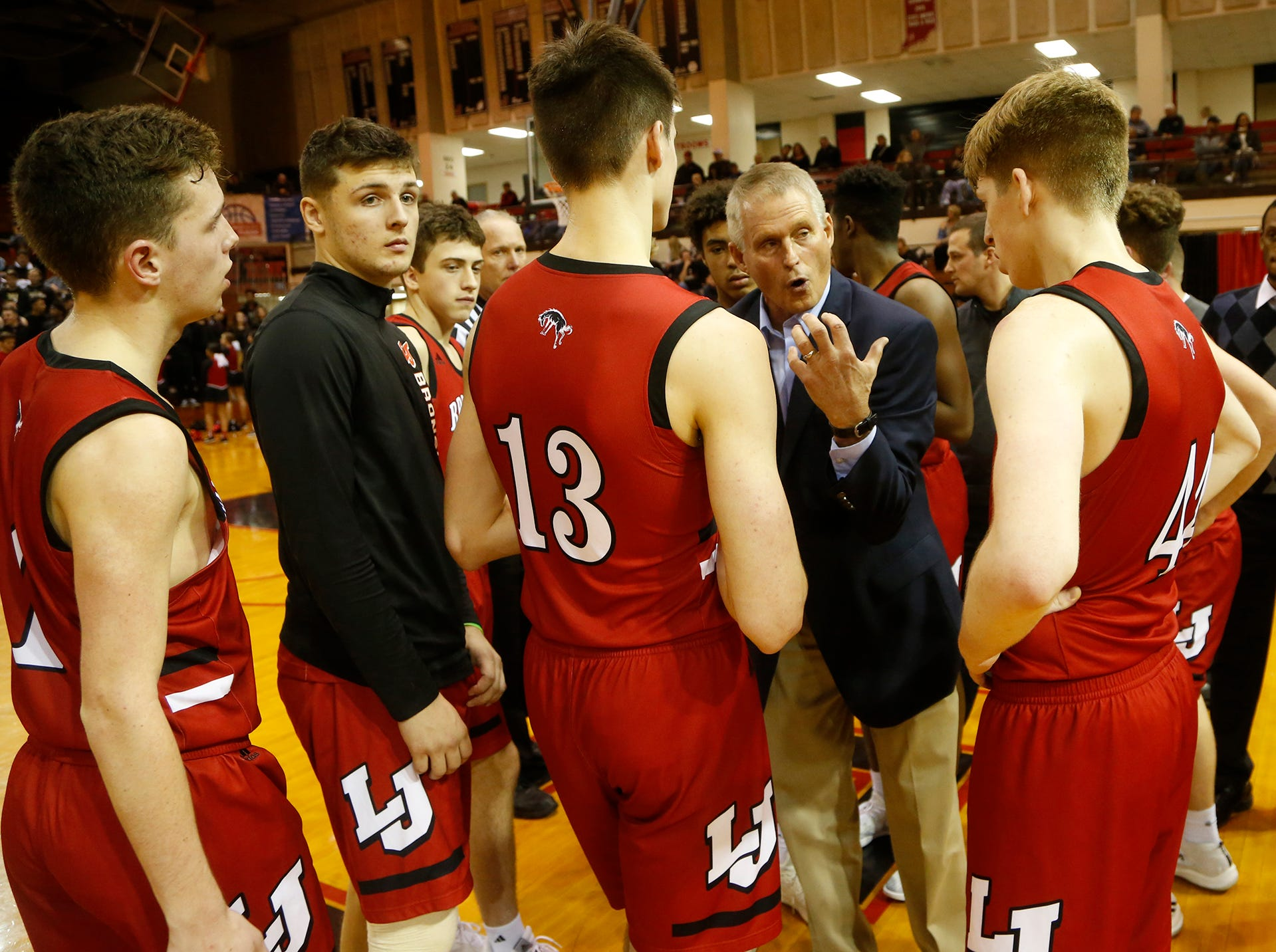 Lafayette Jeff head coach Mark Barnhizer talks sets up a play during a timeout against Central Catholic in the championship of the Franciscan Health Hoops Classic Saturday, December 1, 2018, at Lafayette Jeff. Jeff defeated Central Catholic 76-73 for the title.