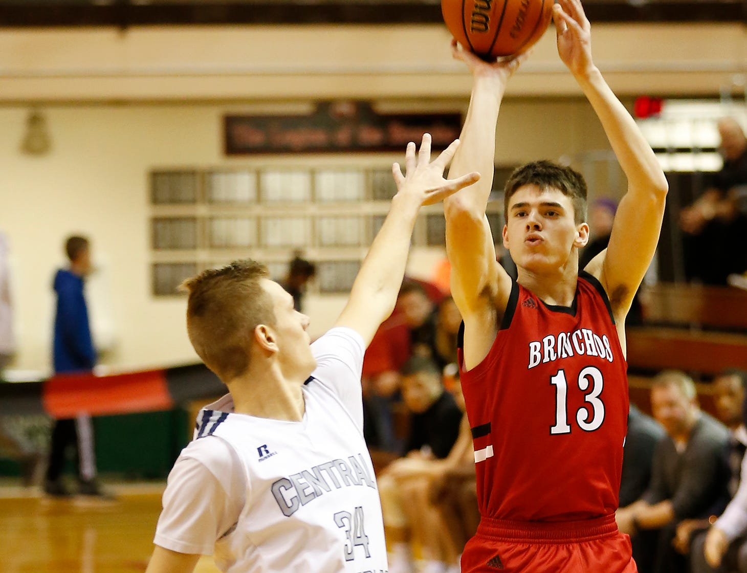 Brooks Barnhizer of Lafayette Jeff with a three-point shot over Carson Barrett of Central Catholic in the championship of the Franciscan Health Hoops Classic Saturday, December 1, 2018, at Lafayette Jeff. Jeff defeated Central Catholic 76-73 for the title.