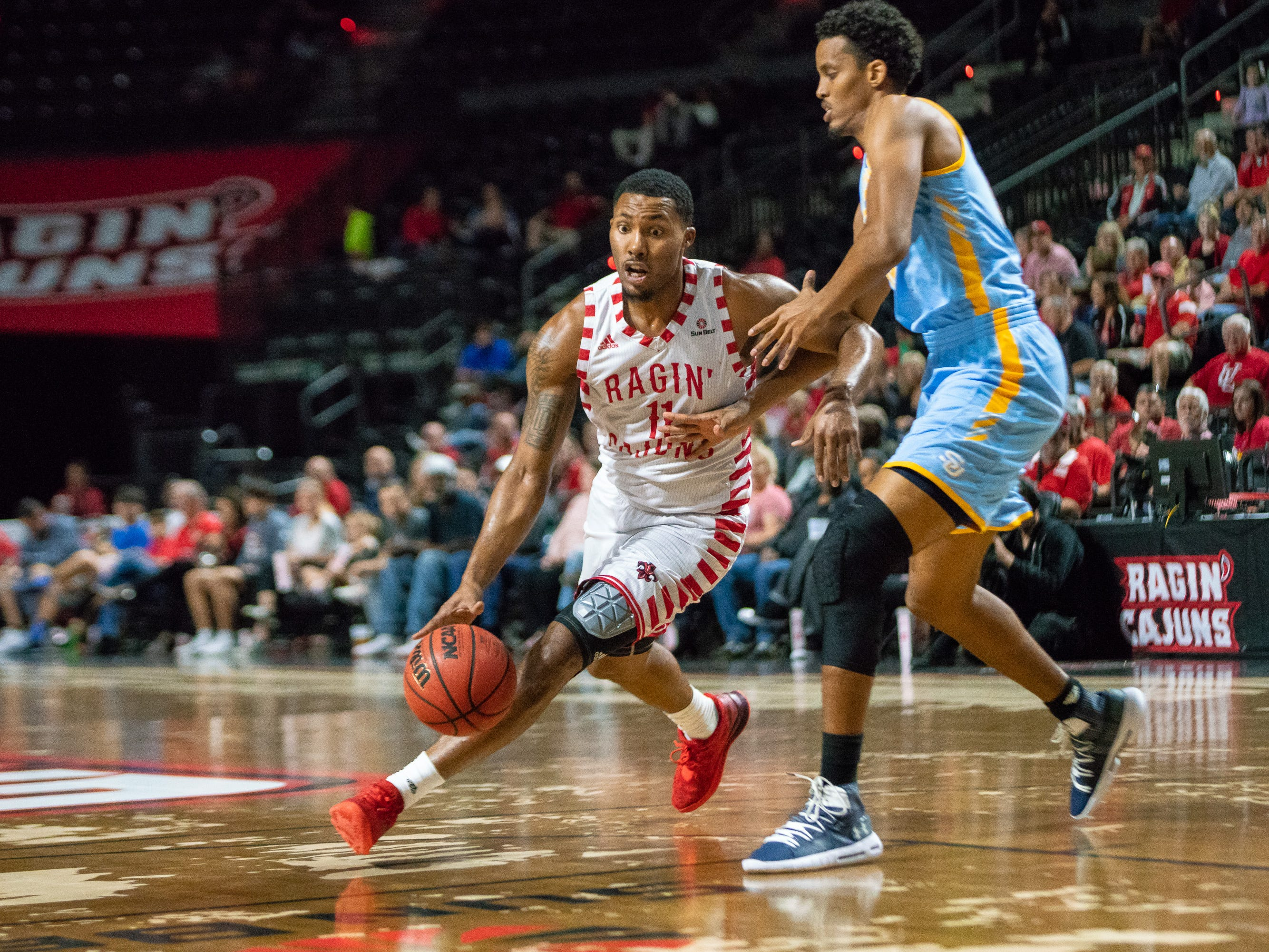 UL's Jerekius Davis fights to get to the goal as the Ragin' Cajuns play against the Southern University Jaguars at the Cajundome on December 1, 2018.