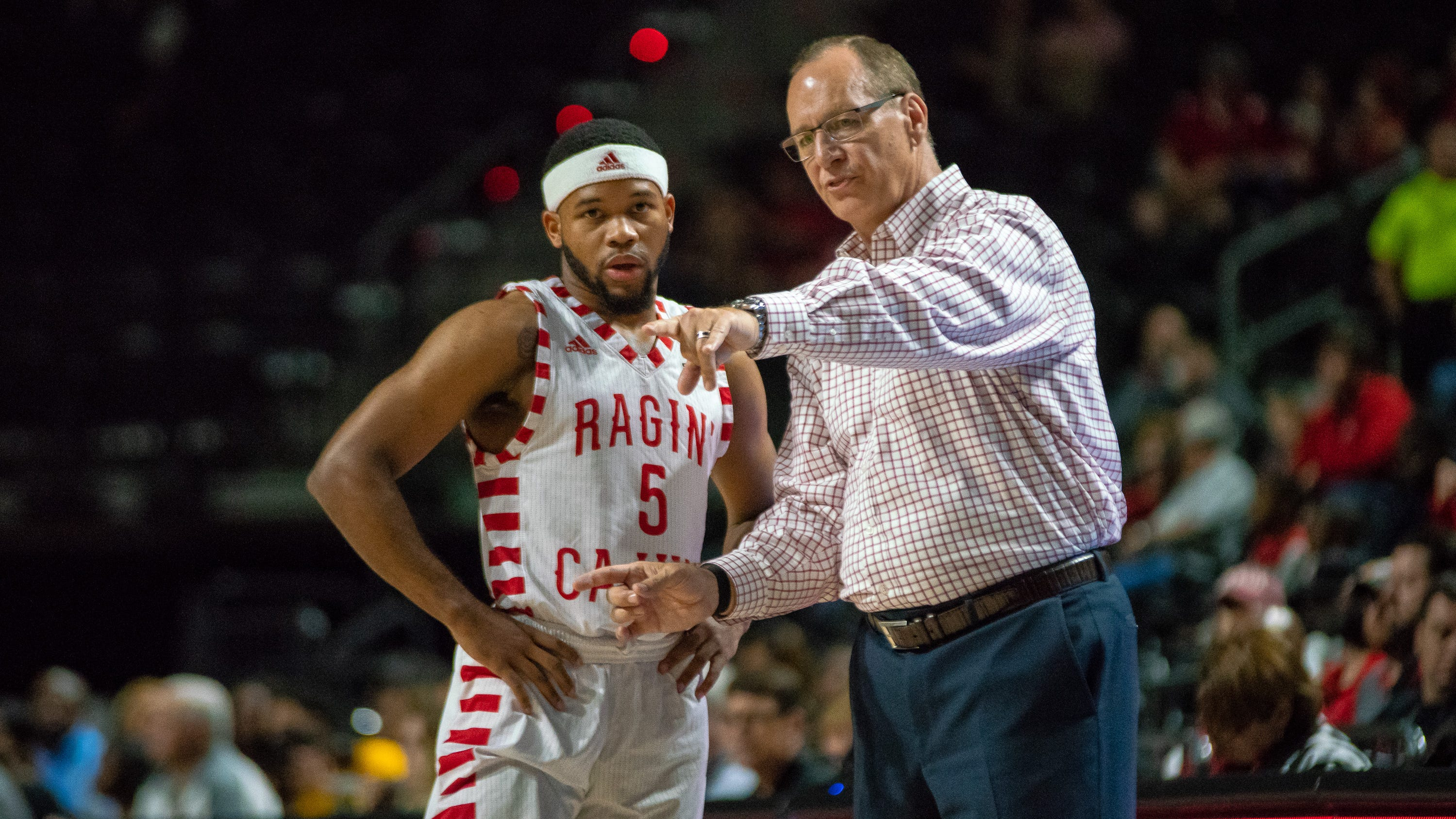 UL's head coach Bob Marlin talks to Trajan Wesley on the sidelines as the Ragin' Cajuns play against the Southern University Jaguars at the Cajundome on December 1, 2018.