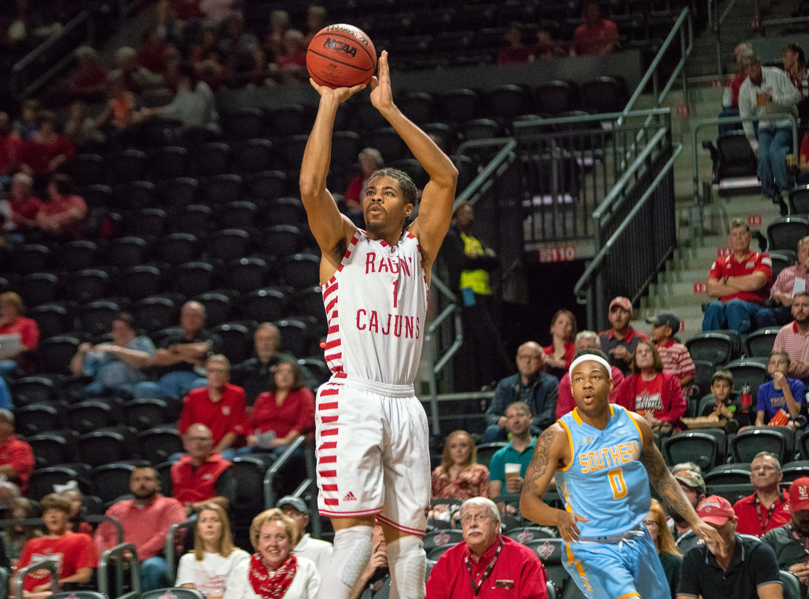 UL's Malik Marquetti shoots a three-pointer as the Ragin' Cajuns play against the Southern University Jaguars at the Cajundome on December 1, 2018.