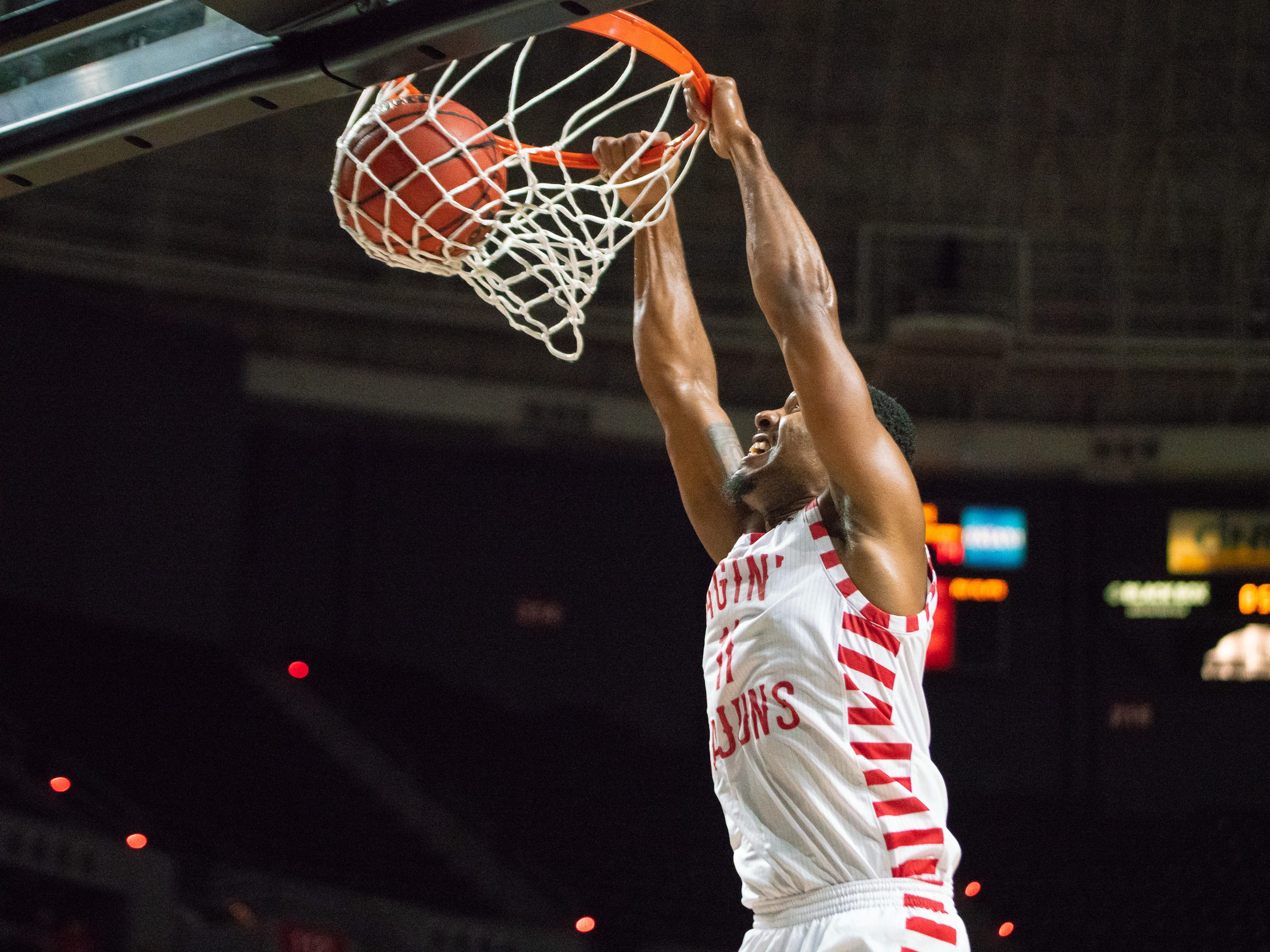 UL's Jerekius Davis leaps up to the goal for a dunk as the Ragin' Cajuns play against the Southern University Jaguars at the Cajundome on December 1, 2018.