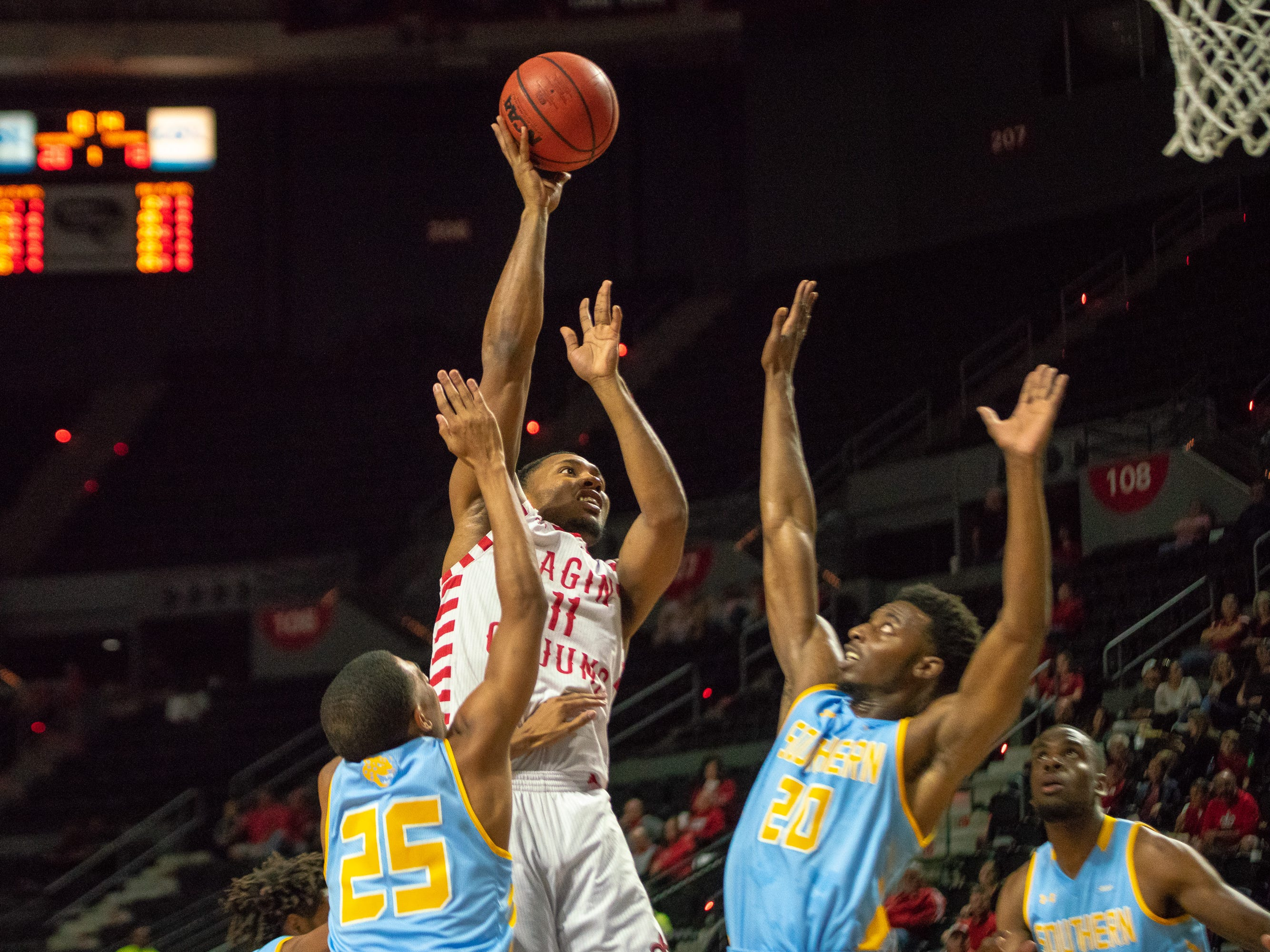 UL's Jerekius Davis shoots over the defenders as the Ragin' Cajuns play against the Southern University Jaguars at the Cajundome on December 1, 2018.