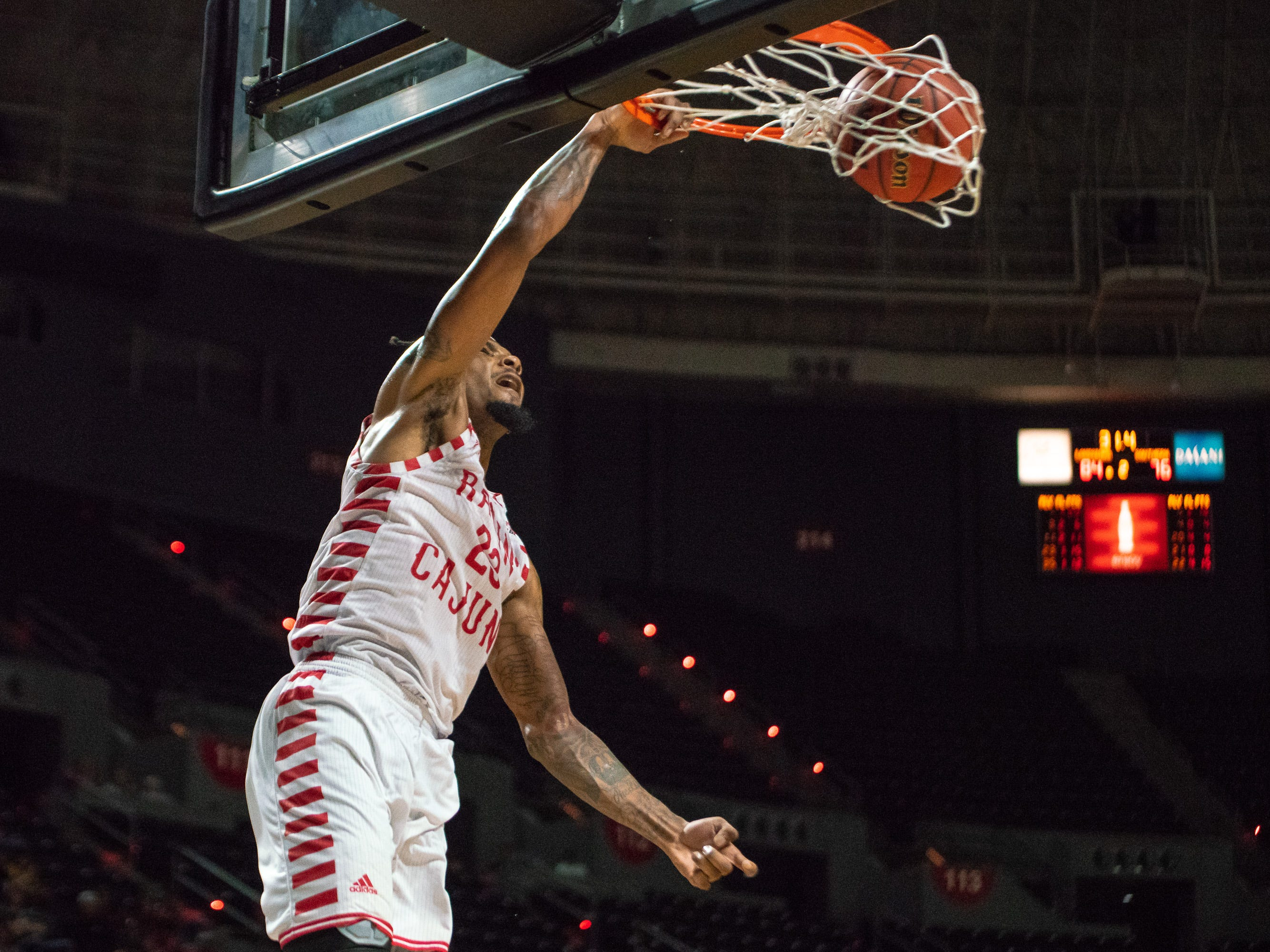 UL's Jakeenan Gant scores with a dunk as the Ragin' Cajuns play against the Southern University Jaguars at the Cajundome on December 1, 2018.
