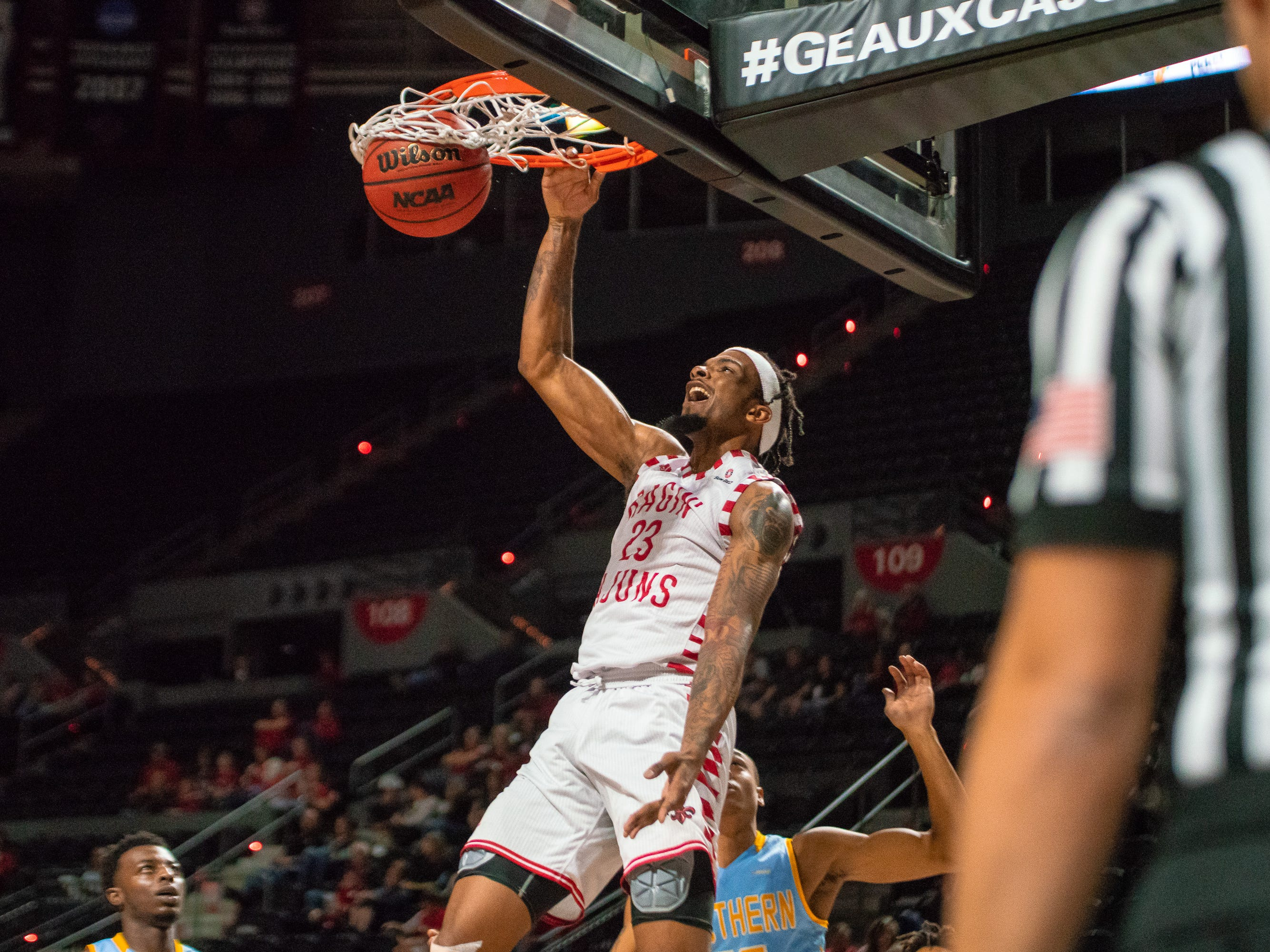 UL's Jakeenan Gant scores a dunk as the Ragin' Cajuns play against the Southern University Jaguars at the Cajundome on December 1, 2018.