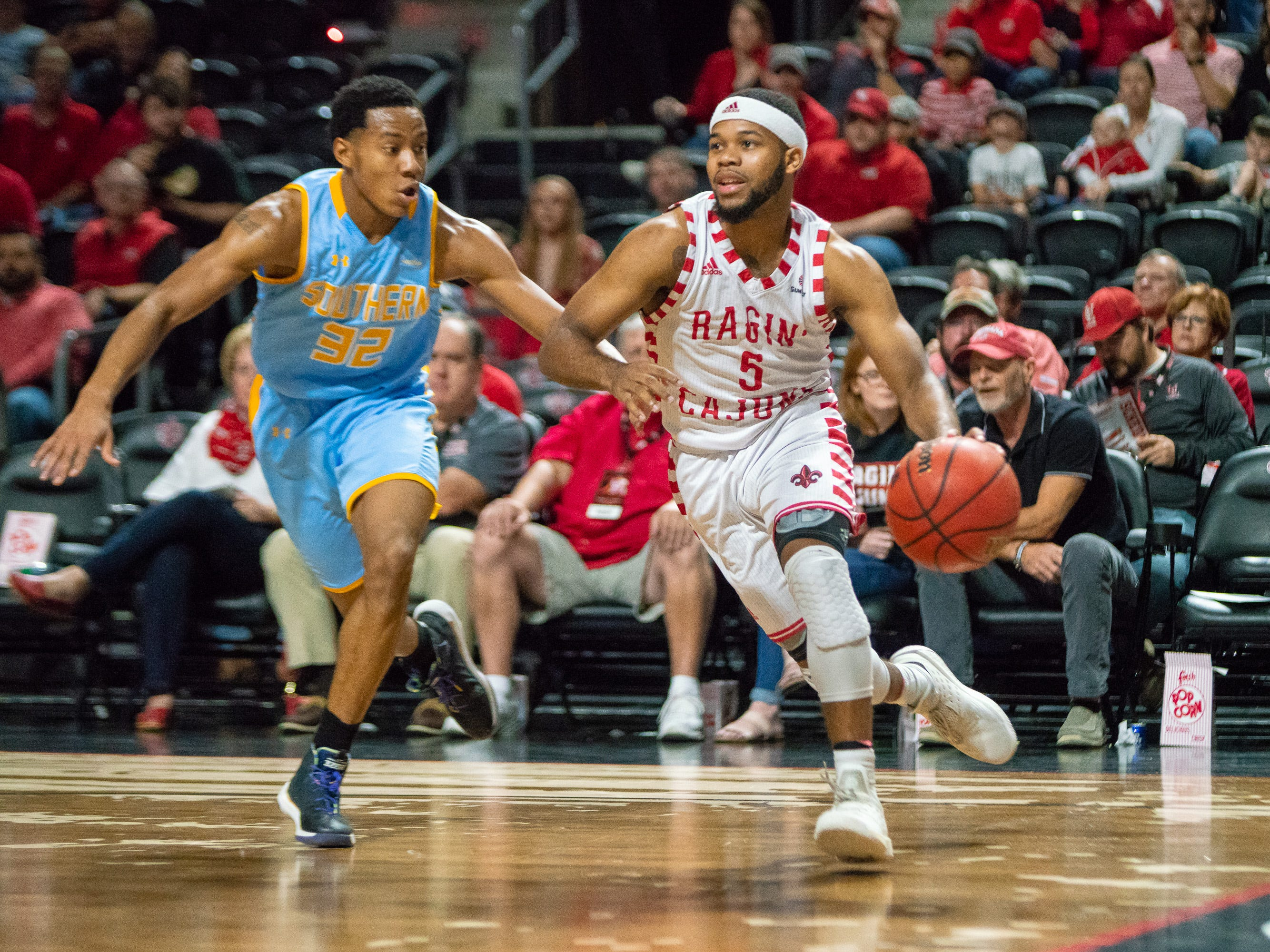 UL's Trajan Wesley dribbles to the goal as the Ragin' Cajuns play against the Southern University Jaguars at the Cajundome on December 1, 2018.