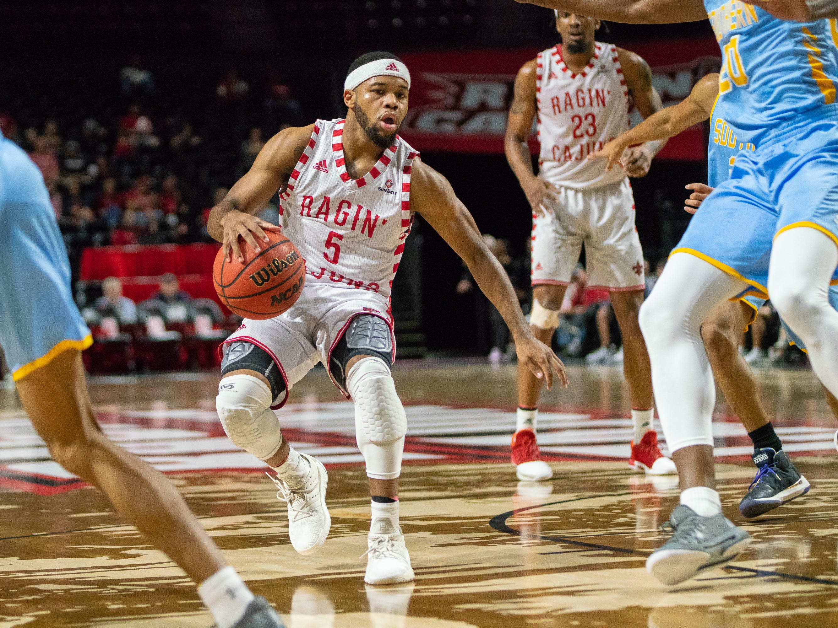 UL's Trajan Wesley moves the ball on the court as the Ragin' Cajuns play against the Southern University Jaguars at the Cajundome on December 1, 2018.
