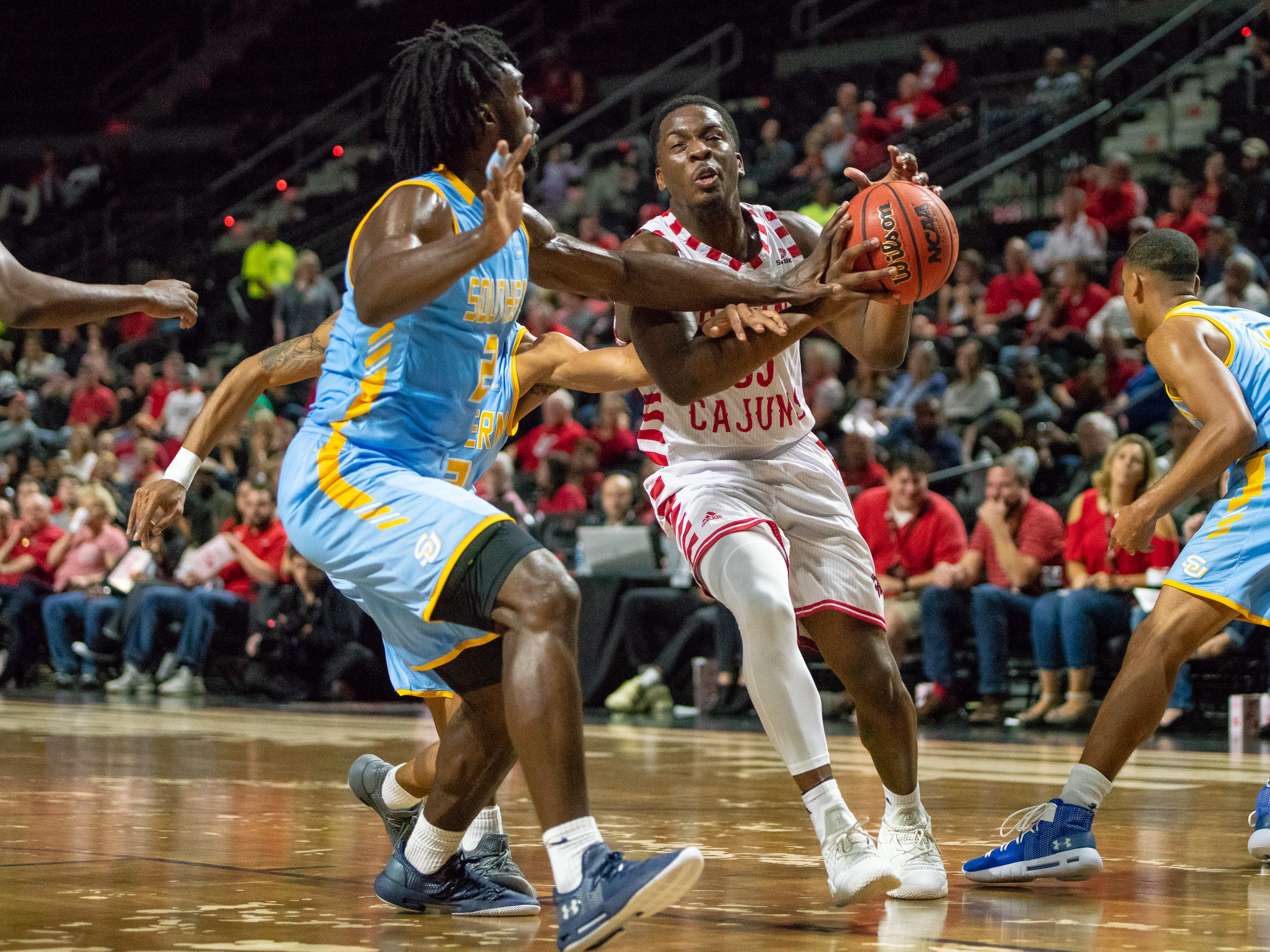 UL's Marcus Stroman gets fouled while going to the goal as the Ragin' Cajuns play against the Southern University Jaguars at the Cajundome on December 1, 2018.