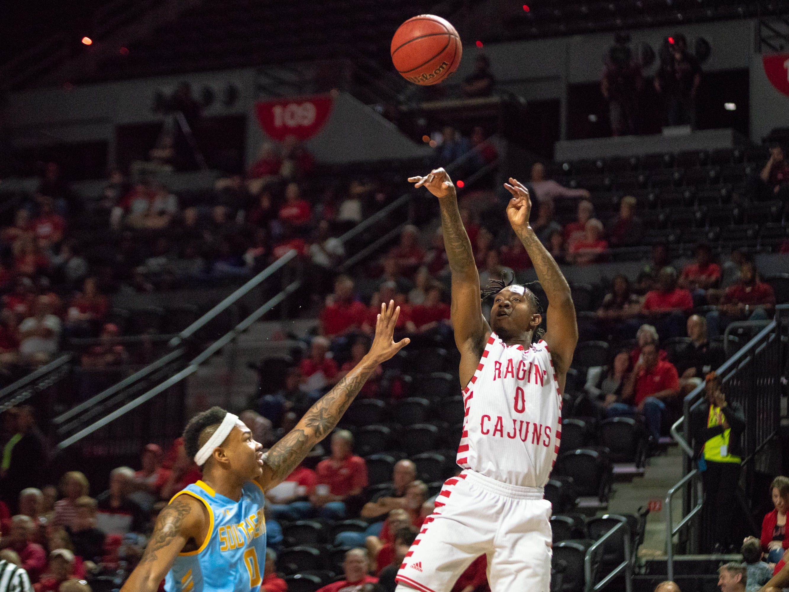 UL's Cedric Russell shoots from the three-point line as the Ragin' Cajuns play against the Southern University Jaguars at the Cajundome on December 1, 2018.