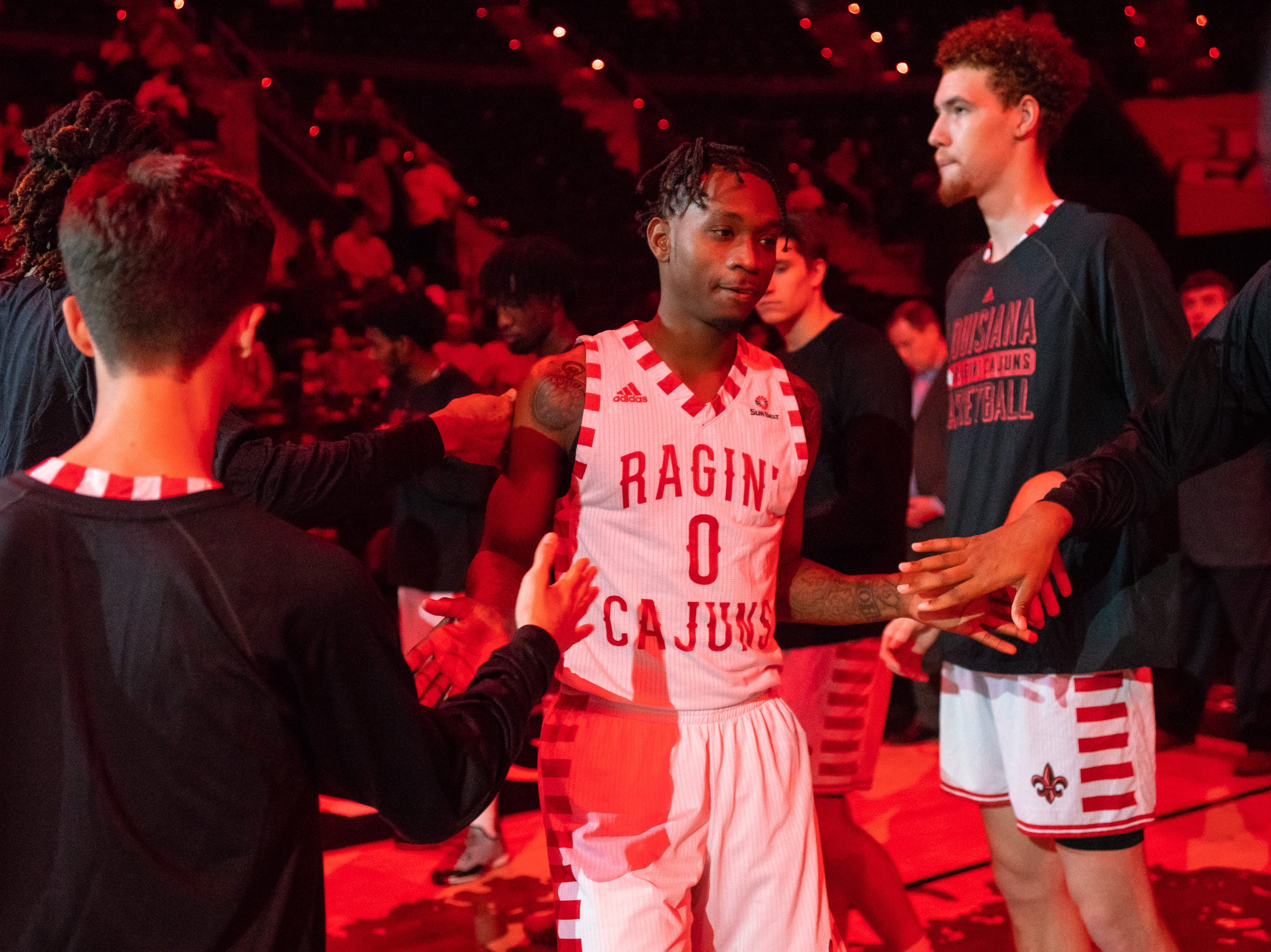 UL's Cedric Russell walks onto the court at the beginning of the game as the Ragin' Cajuns play against the Southern University Jaguars at the Cajundome on December 1, 2018.