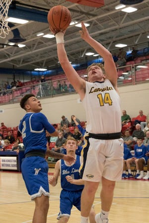 Lancaster's Owen Snyder goes up for a shot against Washington Court House during the Zane Trace Tip-Off Classic Saturday night. The Gales won , 45-42.