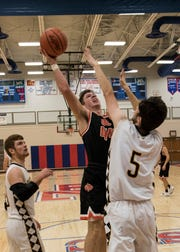 Amanda-Clearcreek senior Will Riffle goes in for two of his 14 points against Paint Valley during the Zane Trace Tip-Off Classic Saturday night. The Aces cruised to a 76-43 win.