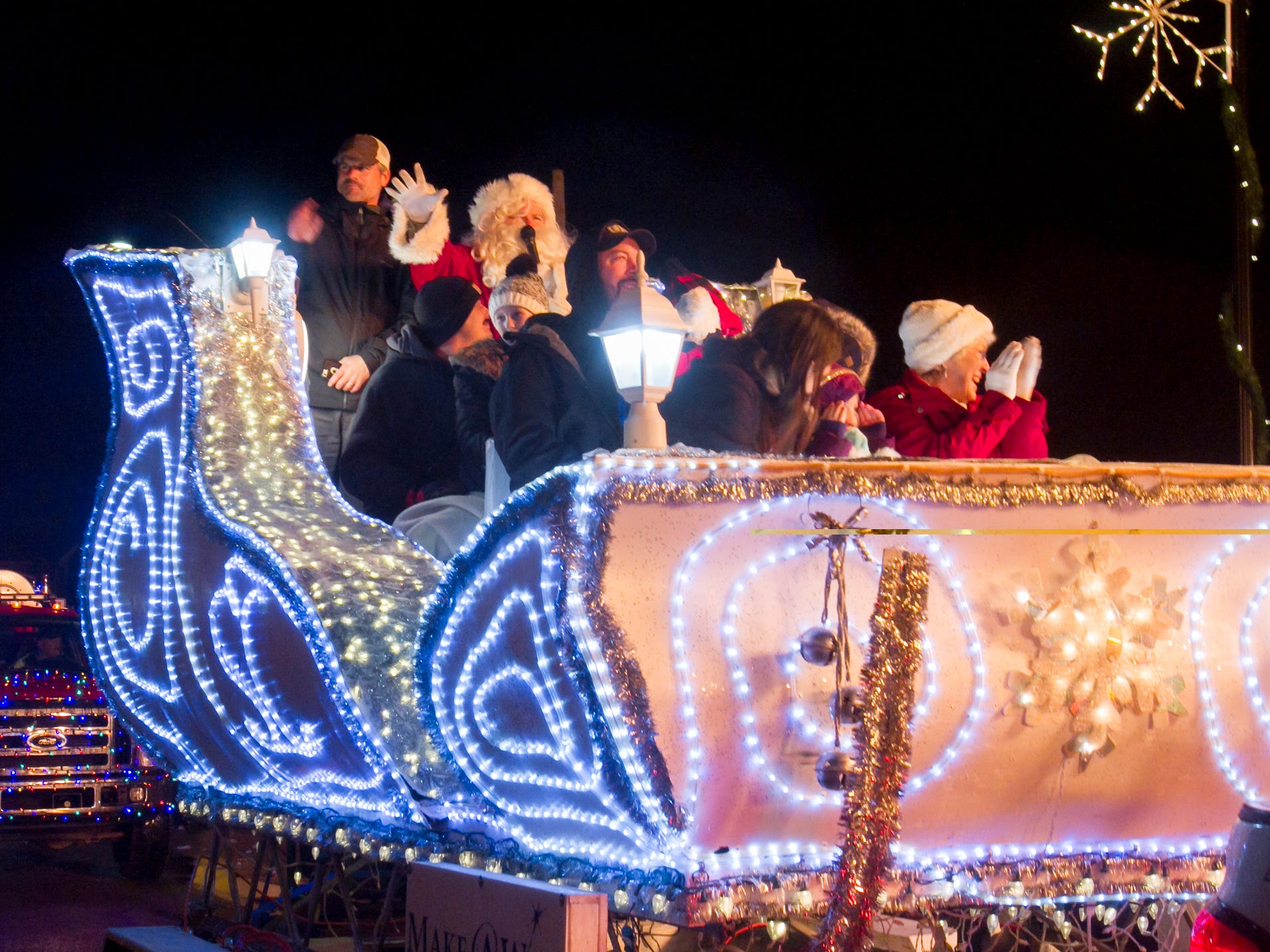 Santa waves from his sleigh, sponsored by Make a Wish in the Christmas in the 'Ville parade Saturday, Dec. 1, 2018.