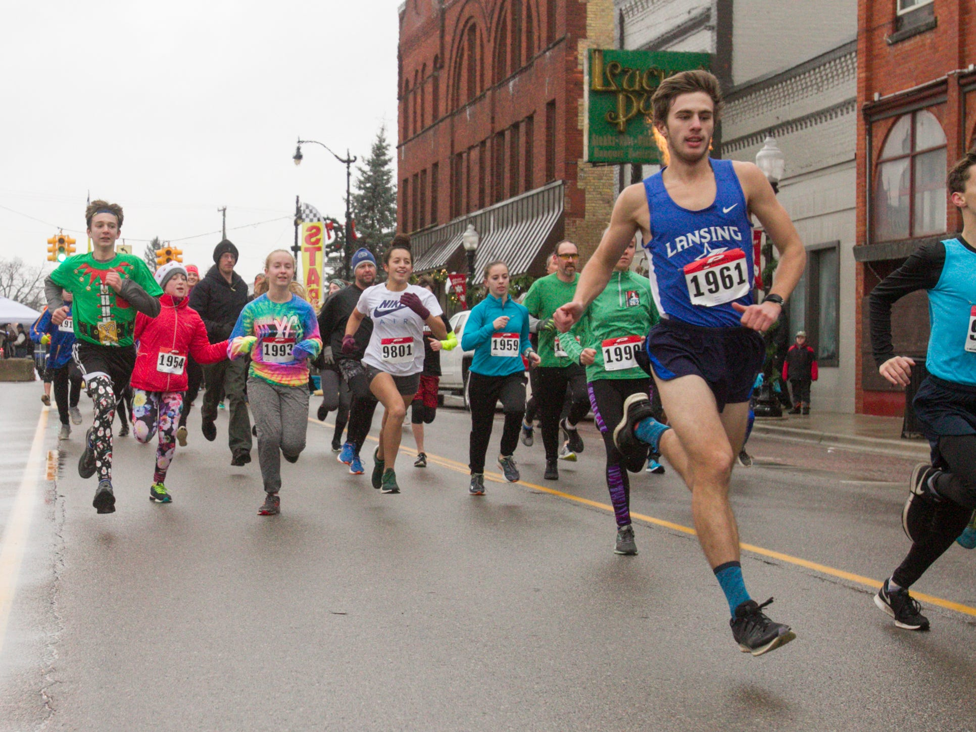 Runners set their pace in the beginning of the Dashing Through the Snow 5K run/walk, part of the Christmas in the 'Ville festivities Saturday, Dec. 1, 2018.