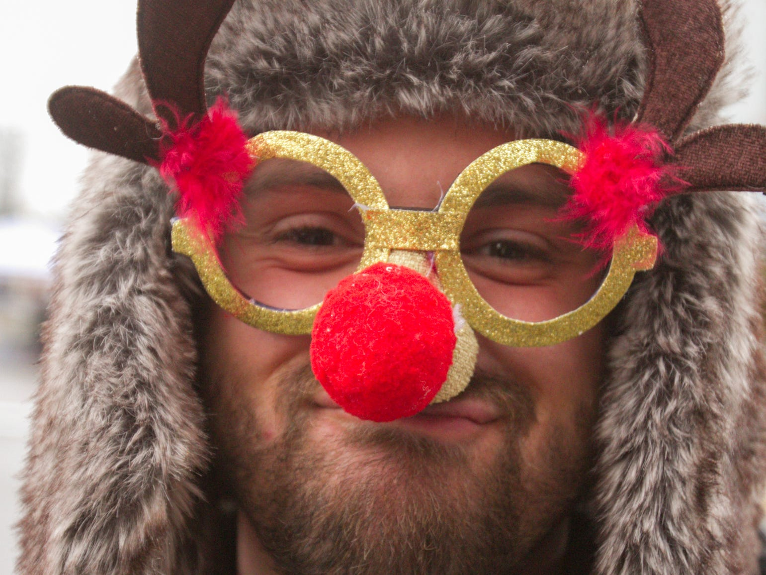 David West of Ferndale, visiting family in Fowlerville, got into the spirit of the Christmas in the 'Ville festivities Saturday, Dec. 1, 2018.