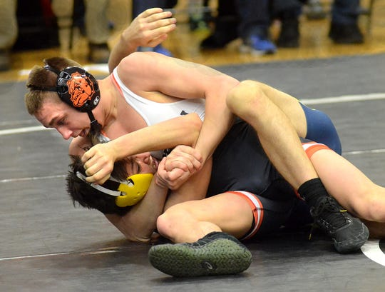 Brighton junior Eddie Homrock (top) was a team captain as a sophomore when he placed fourth in the state.