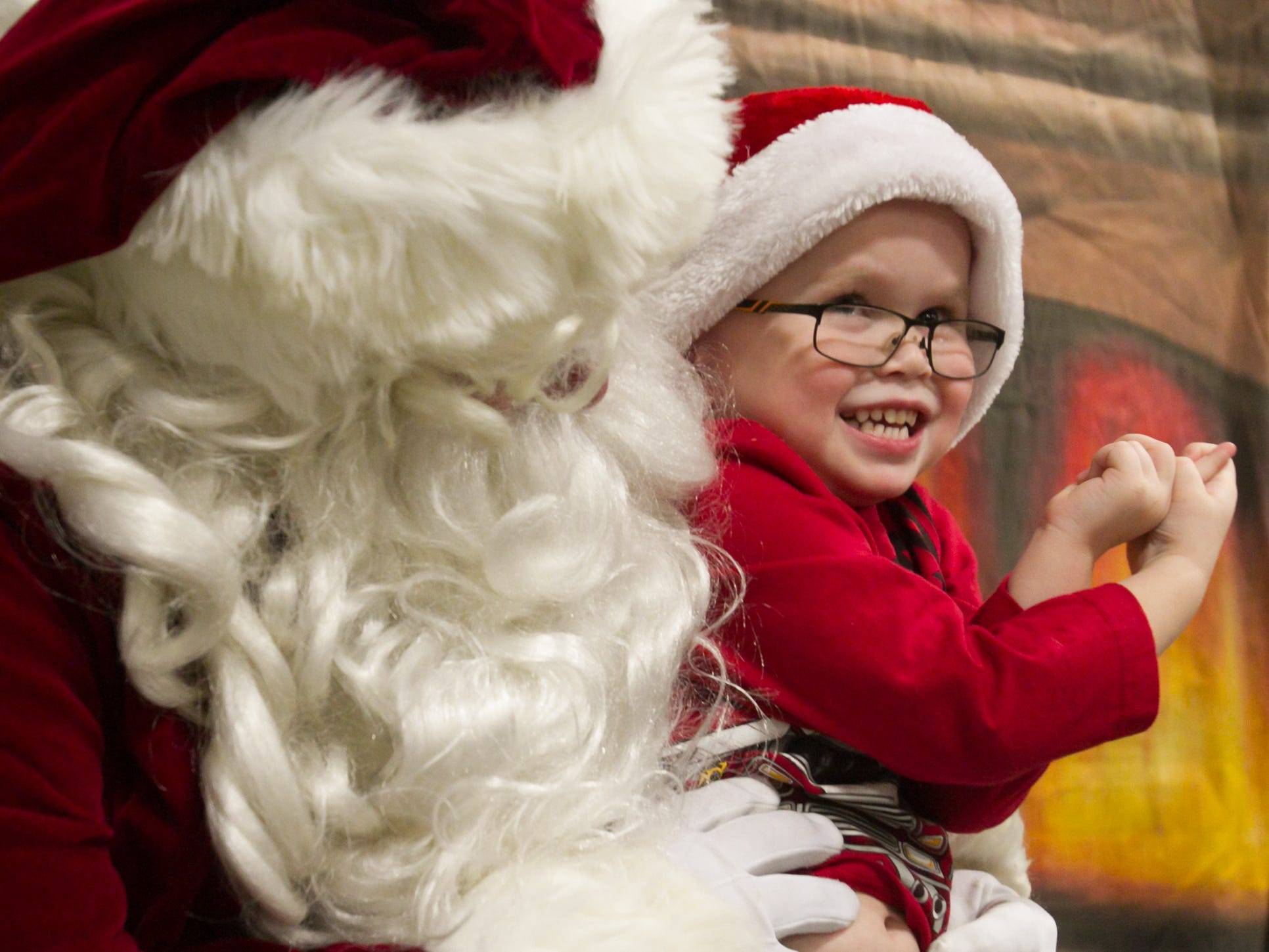 3-year-old Barron Snyder showed his enthusiasm while telling Santa what he wants for Christmas at the fire hall during the Christmas in the 'Ville  Saturday, Dec. 1, 2018.