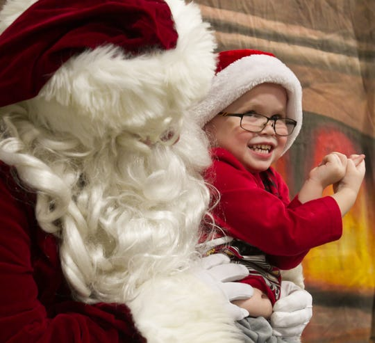 """Barron Snyder showed his enthusiasm while telling Santa what he wants for Christmas at Fowlerviller's fire hall during """"Christmas in the 'Ville""""  Saturday, Dec. 1, 2018."""