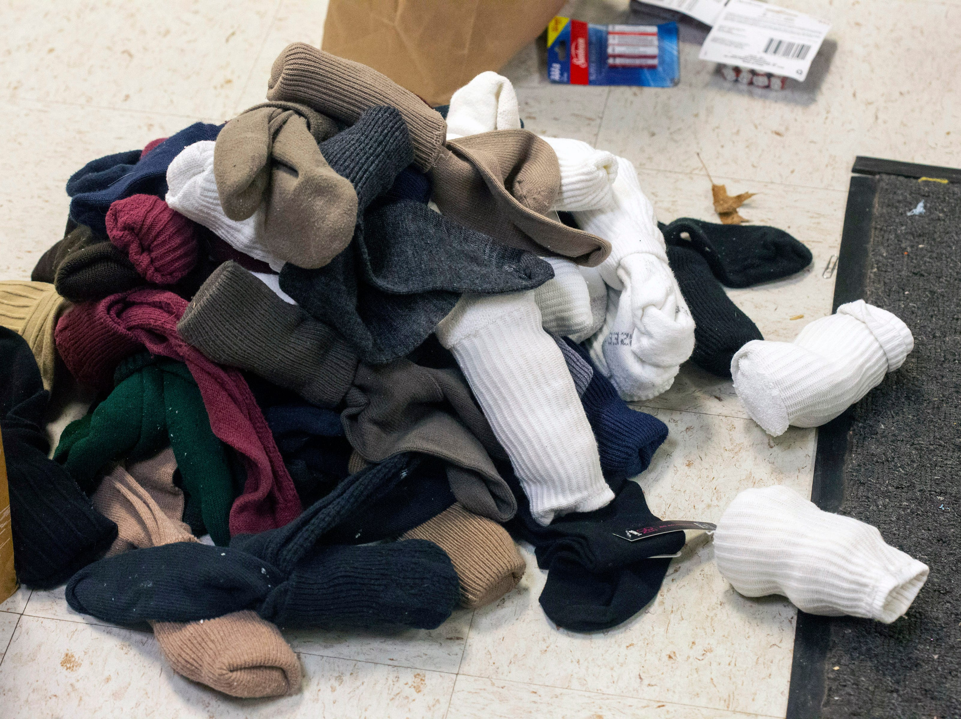 Socks are sorted into a pile for distribution to the homeless. 11/26/18