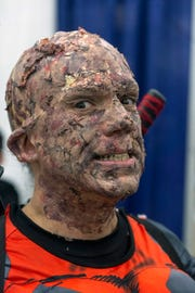Randy Pack paid attention to detail in his makeup job as the unmasked Deadpool. 12/1/18