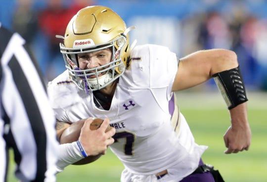 Male High School's Garrett Dennis plows foreward for a touchdown against Scott County. Dec. 1, 2018