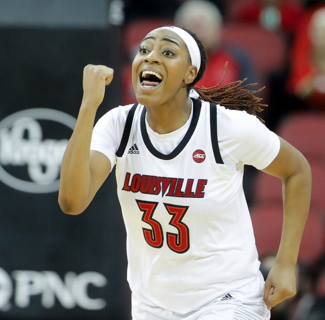 Louisville's Bionca Dunham communicates with her teammates after scoring against Tennessee State. Dec. 2, 2018