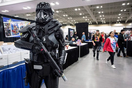 Cosplayers posed for photos with excitement and stature during Louisville SuperCon. 12/1/18