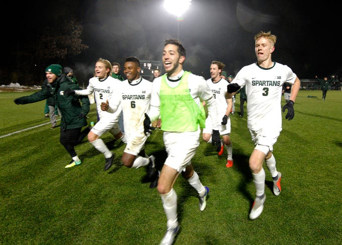 Michigan State players celebrate following their 2-1 win over James Madison, Saturday, Dec. 1, 2018, in East Lansing, Mich. Michigan State won 2-1.