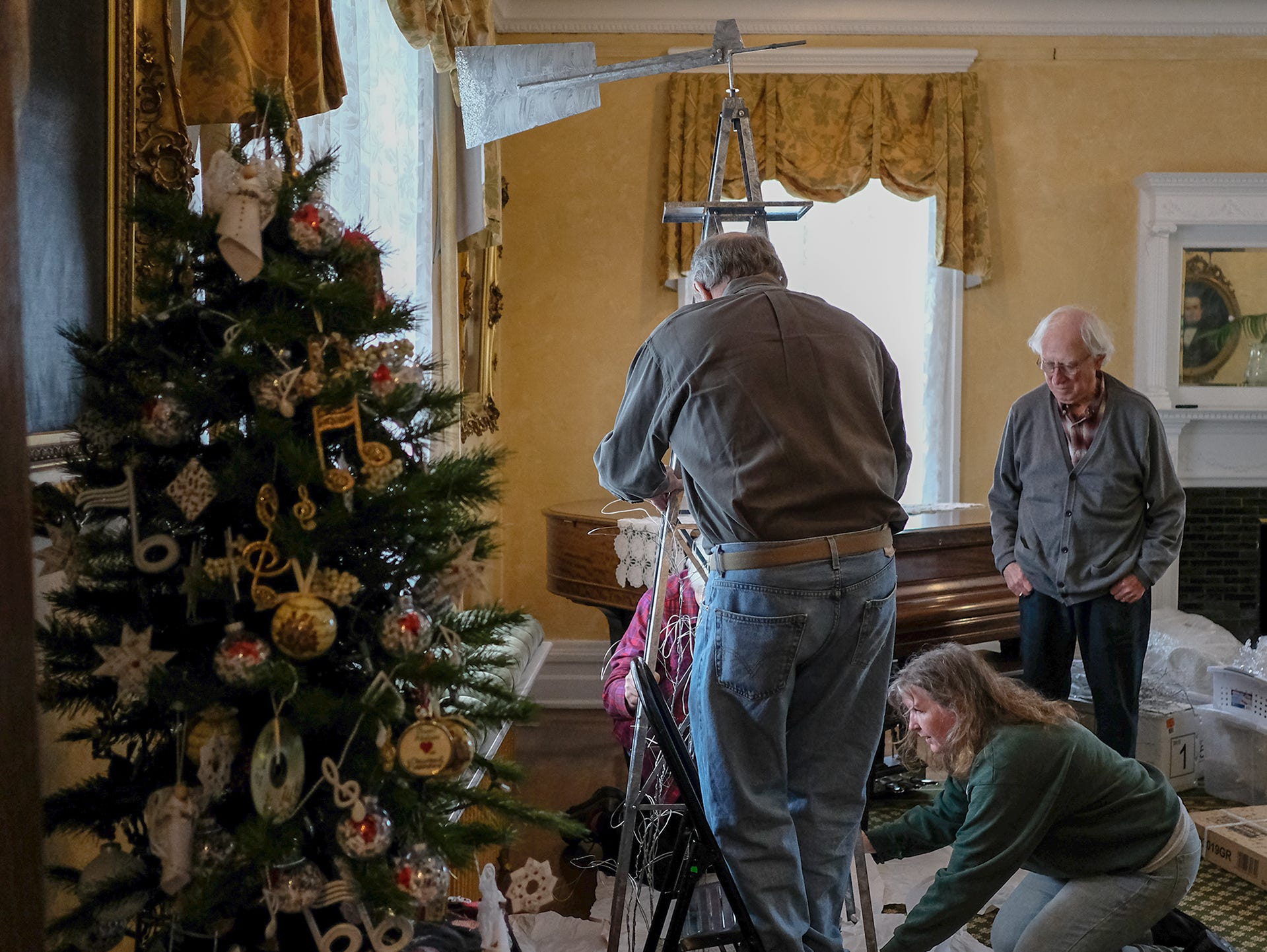 "Friends of the MSU Theatre Department work on an ""Oklahoma"" themed Christmas tree at the Turner-Dodge House in preparation for the annual A Festival of Trees Saturday, Dec. 1, 2018."