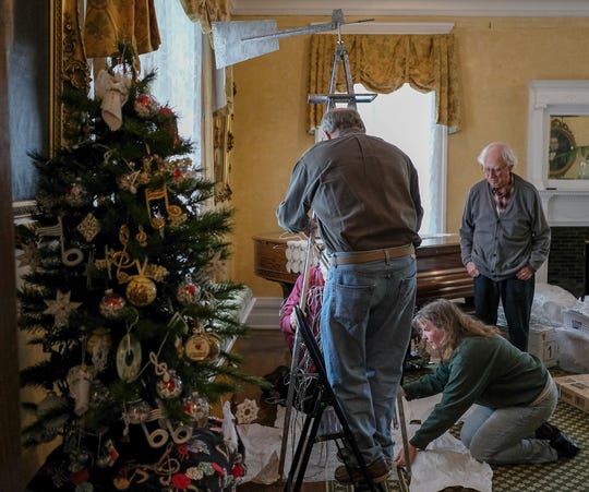 """Friends of the MSU Theatre Department work on an """"Oklahoma"""" themed Christmas tree at the Turner-Dodge House in preparation for the annual A Festival of Trees Saturday, Dec. 1, 2018."""
