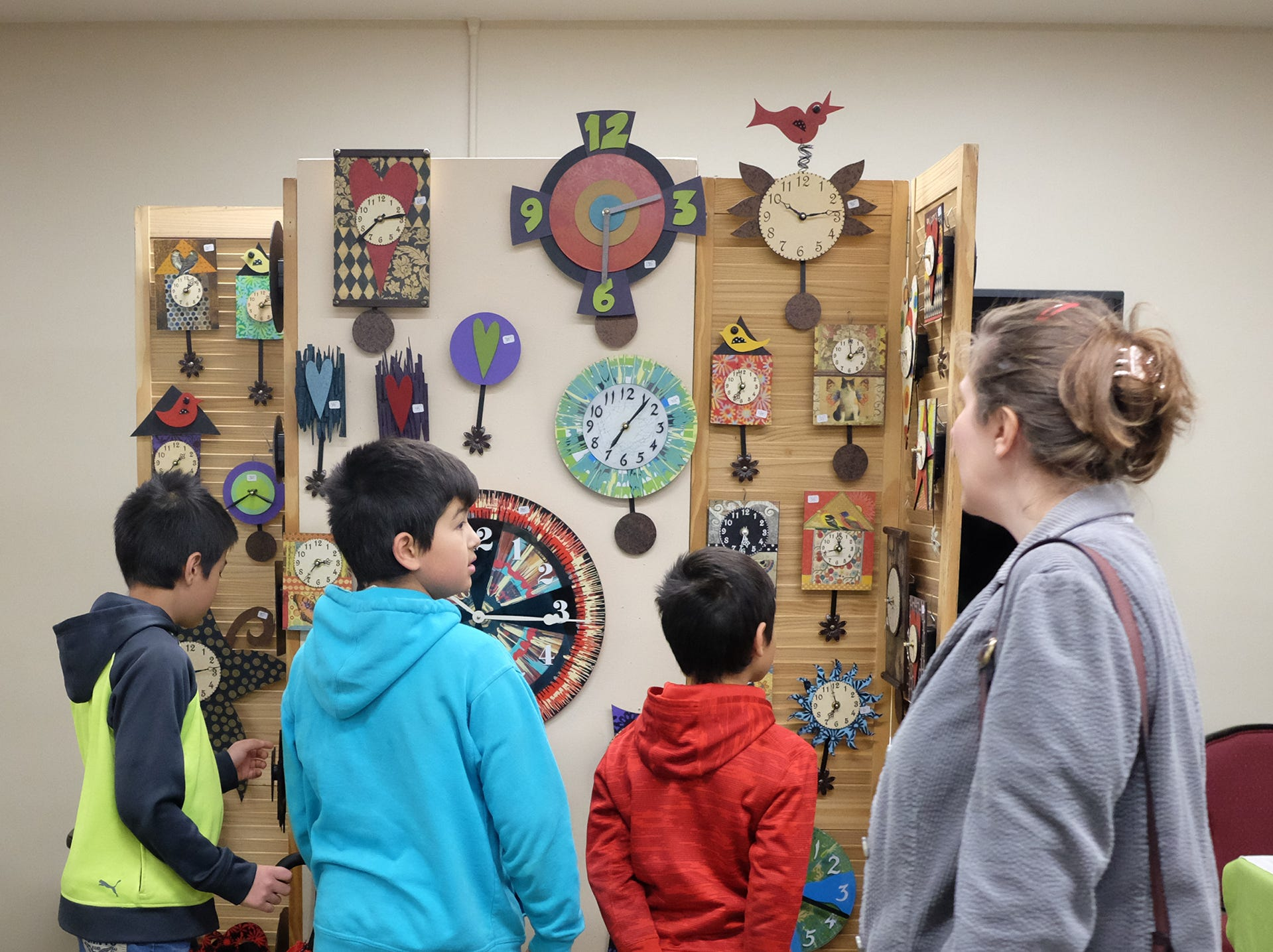 These youngsters are curious about these clocks on display but are told they can't touch them at the MSU Winter Arts & Craft Show Sunday, Dec. 2, 2018.