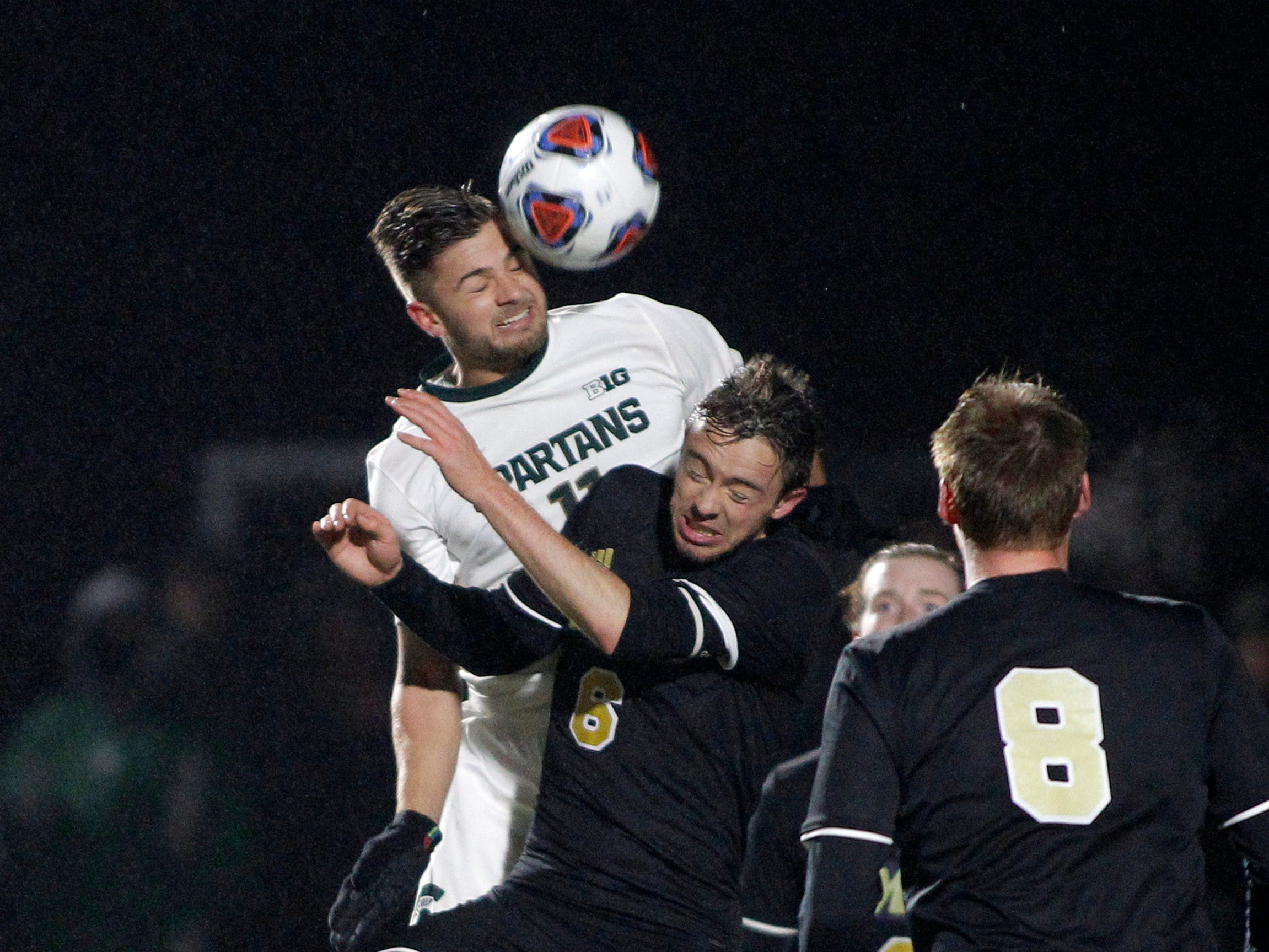Michigan State's Ryan Sierakowski, left, and James Madison's Thomas Shores (6) battle for a header, Saturday, Dec. 1, 2018, in East Lansing, Mich. Michigan State won 2-1.