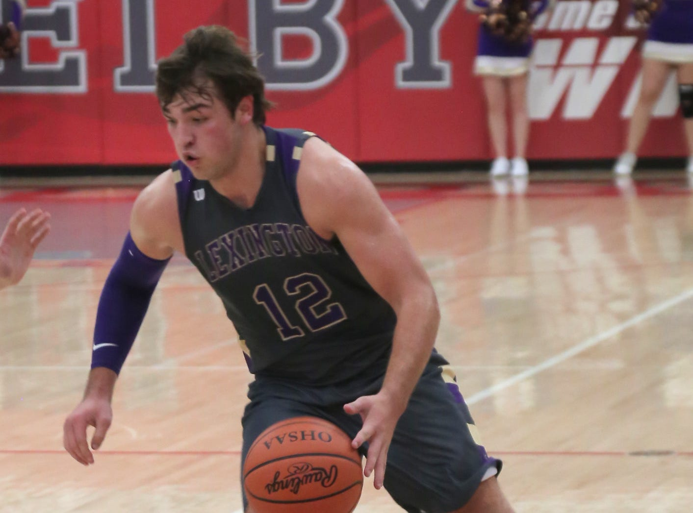 Lexington's Ben Vore dribbles the ball down the court while playing at Shelby on Saturday.