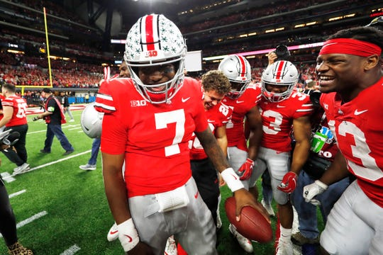 Big Ten Championship Game MVP Dwayne Haskins celebrates Ohio State's 45-24 victory over Northwestern with his teammates.