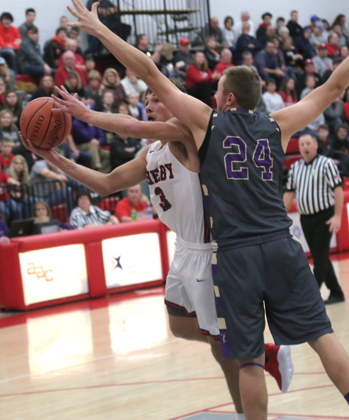 Shelby's Uriah Schwemley is blocked by Lexington's Nick Stehle during a home game on Saturday.