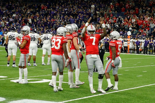 MVP Dwayne Haskins celebrates in the final seconds of Ohio State's 45-24 Big Ten Championship Game win over Northwestern.