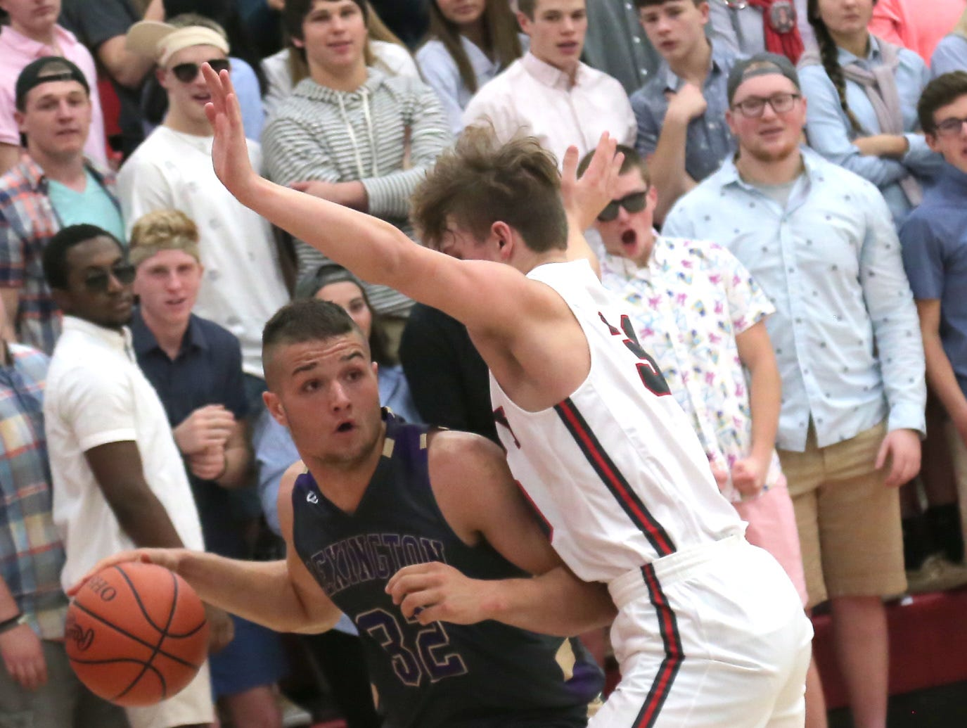 Lexington's Cade Stover dribbles the ball while playing at Shelby on Saturday.