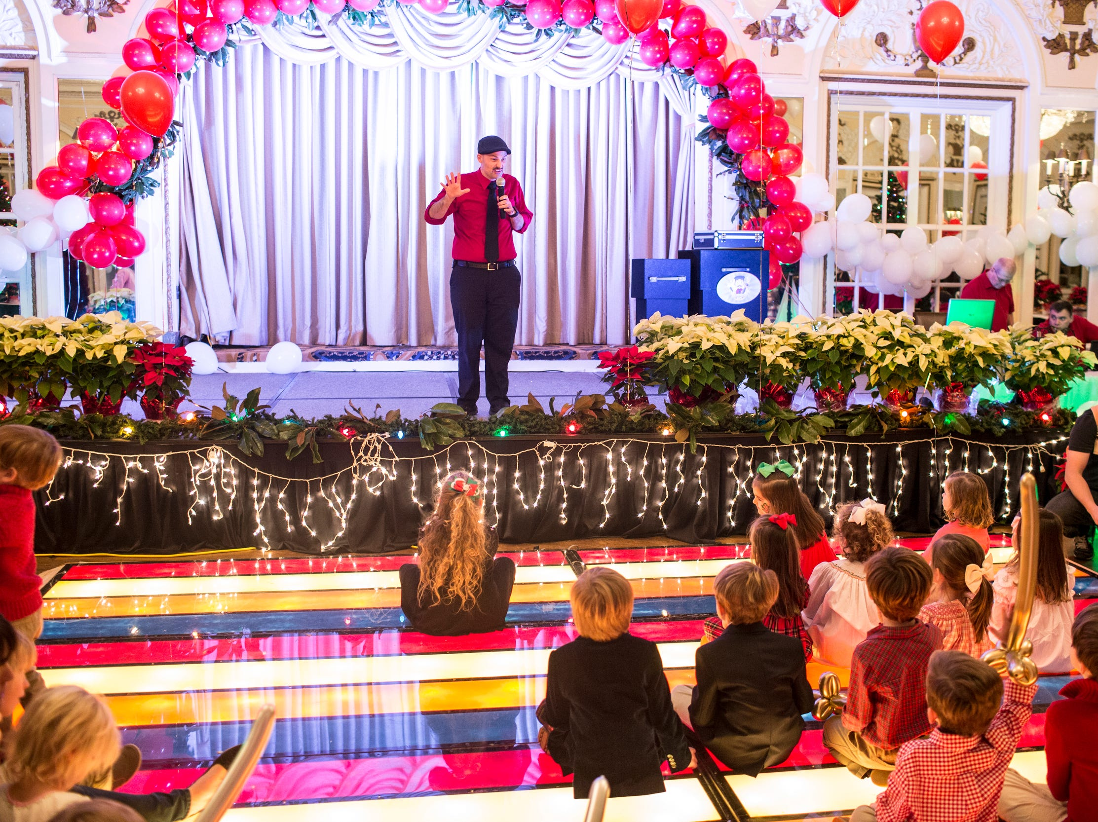 December 02 2018 - Kids gathered around for a magic show during the Memphis Jingle Bell Ball Holiday Cookie Party inside of the Continental Ballroom at the Peabody Hotel on Sunday. This was the 30th anniversary of the Jingle Bell Ball.