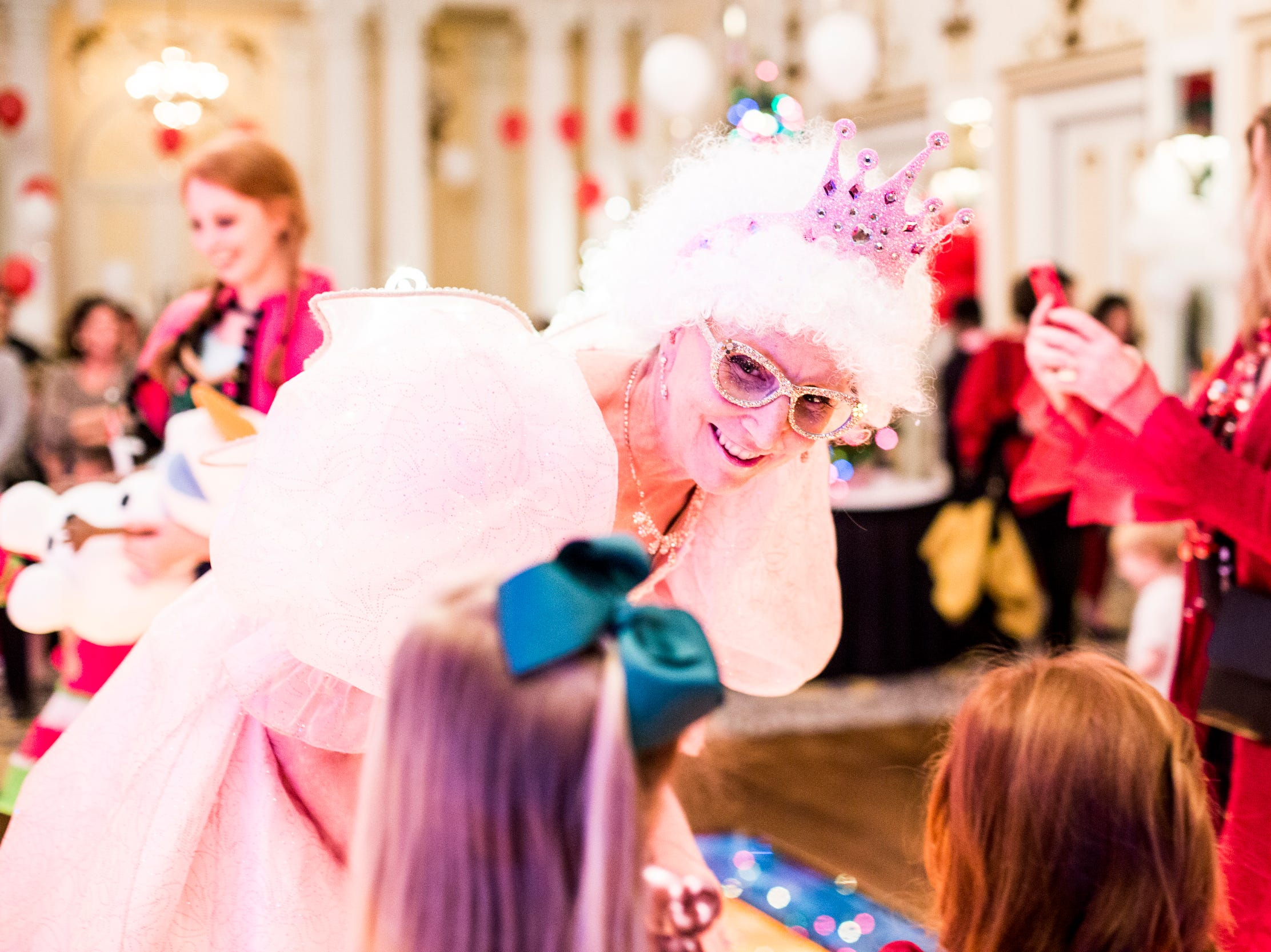 December 02 2018 - Mary Driscoll, dressed as the fairy godmother talks with children during the Memphis Jingle Bell Ball Holiday Cookie Party inside of the Continental Ballroom at the Peabody Hotel on Sunday. This was the 30th anniversary of the Jingle Bell Ball.