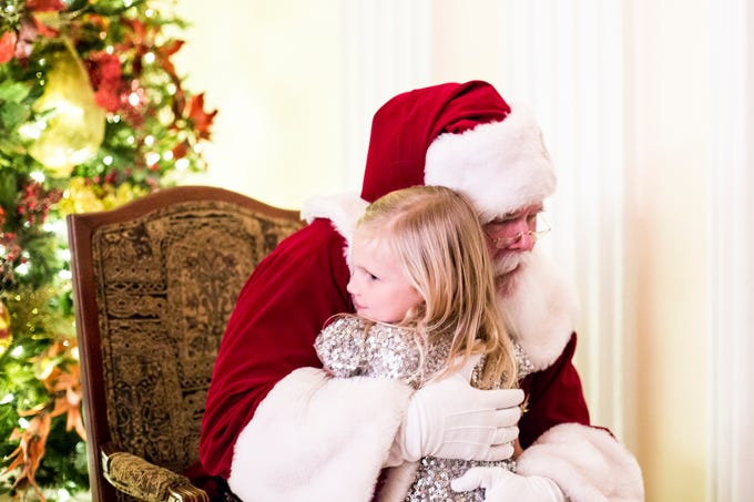 December 02 2018 - Clayton McCollum, 6, hugs Santa Claus during the Memphis Jingle Bell Ball Holiday Cookie Party inside of the Continental Ballroom at the Peabody Hotel on Sunday. This was the 30th anniversary of the Jingle Bell Ball.