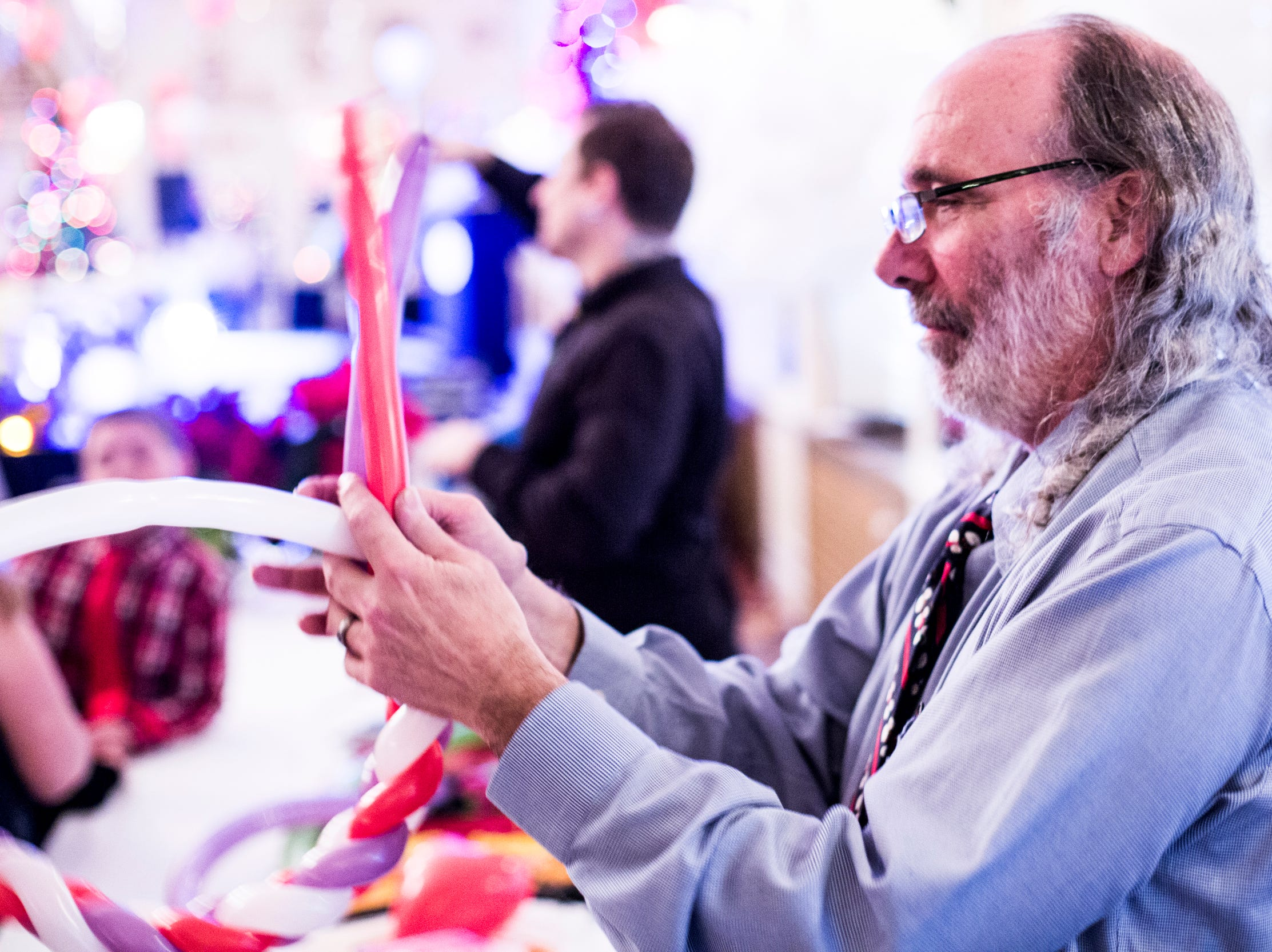 December 02 2018 - Dan Morse, with Twisted Balloons, works to create a balloon crown during the Memphis Jingle Bell Ball Holiday Cookie Party inside of the Continental Ballroom at the Peabody Hotel on Sunday. This was the 30th anniversary of the Jingle Bell Ball.