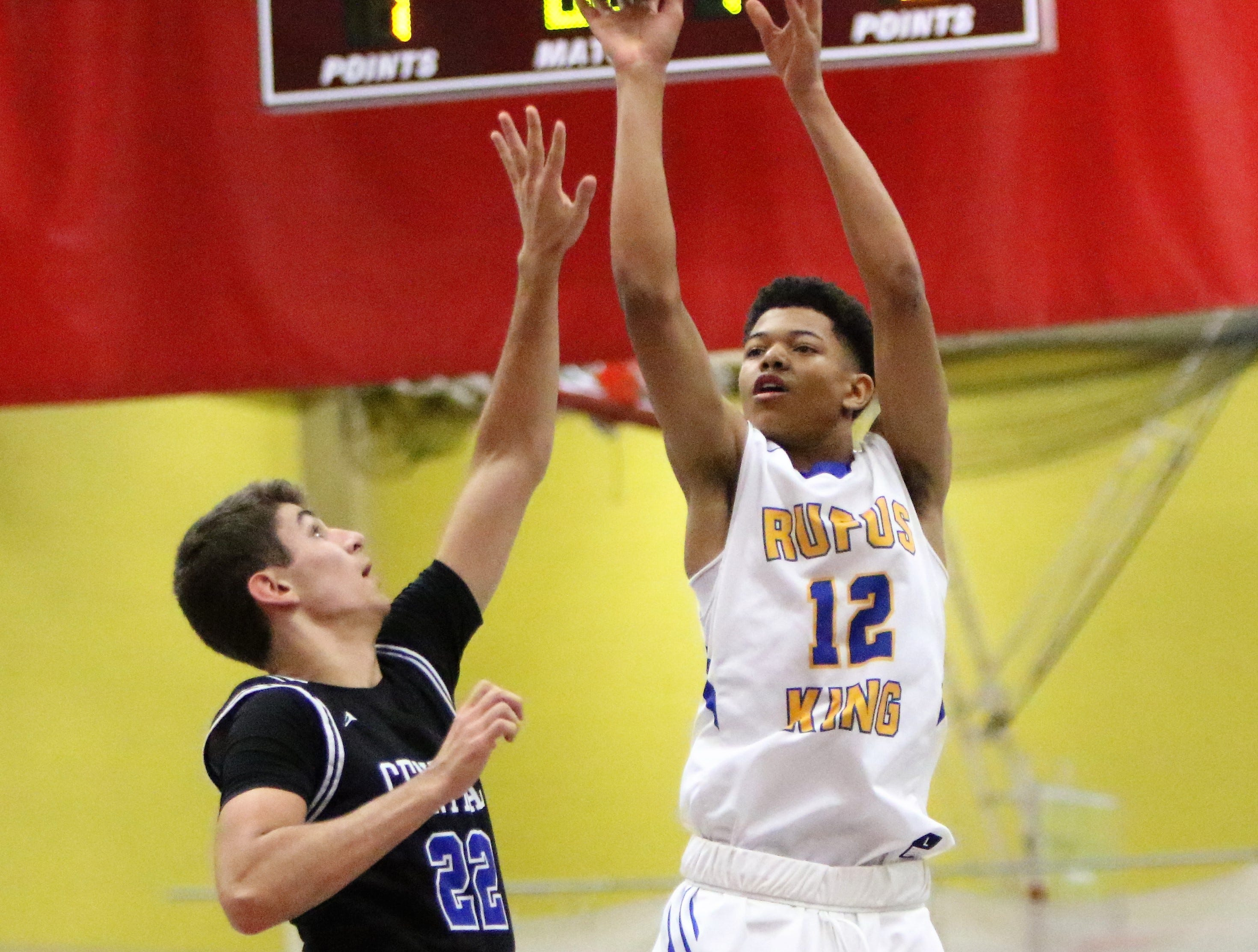 Milwaukee King sophomore Quinton Murrell goes up for a jumper while guarded by Ben Nau of Brookfield Central during the Terry Porter Classic on Saturday.