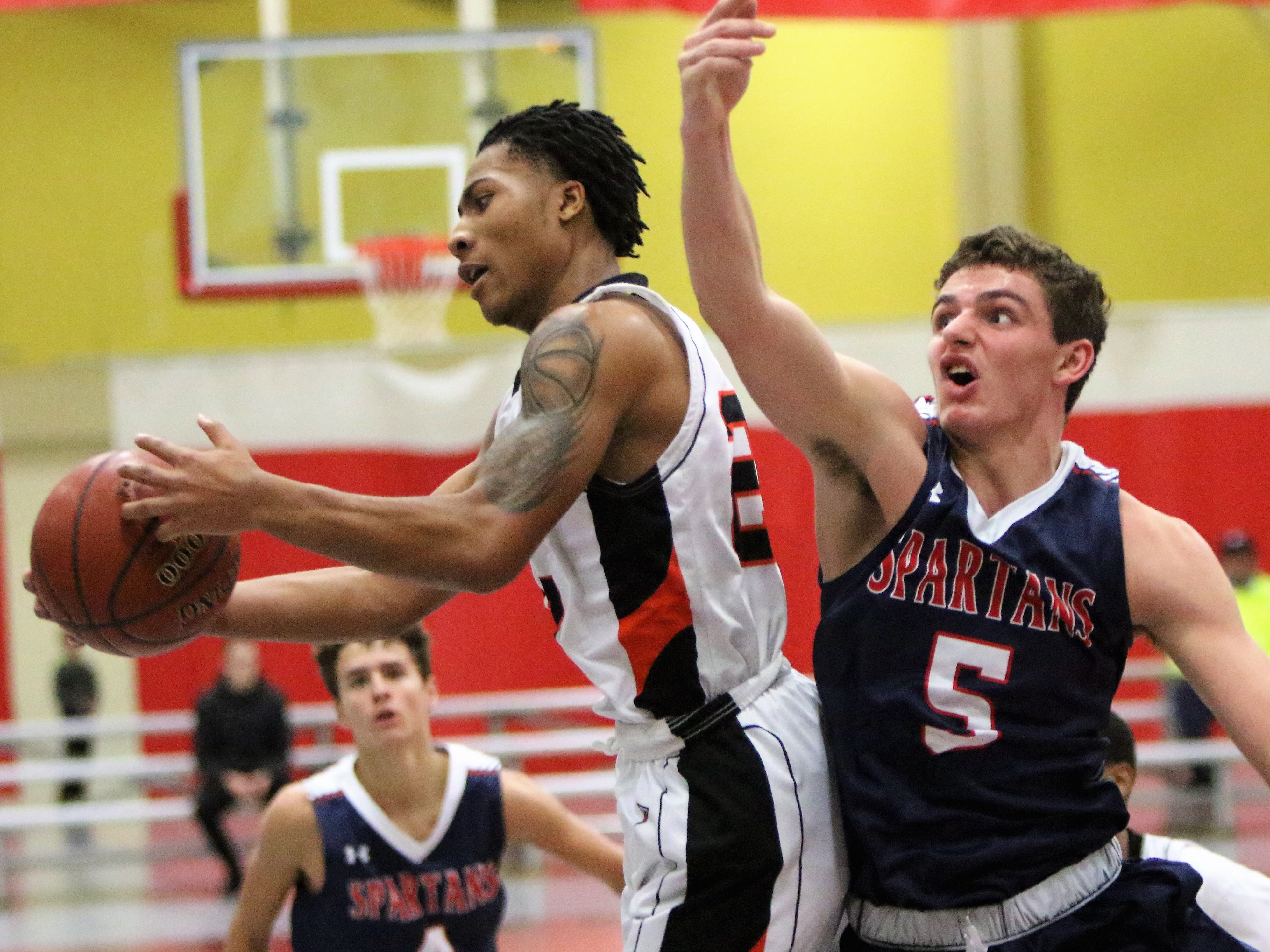 Brookfield East junior Brady Wellman (right) battles for a rebound against Milwaukee Riverside during the Terry Porter Classic on Saturday.