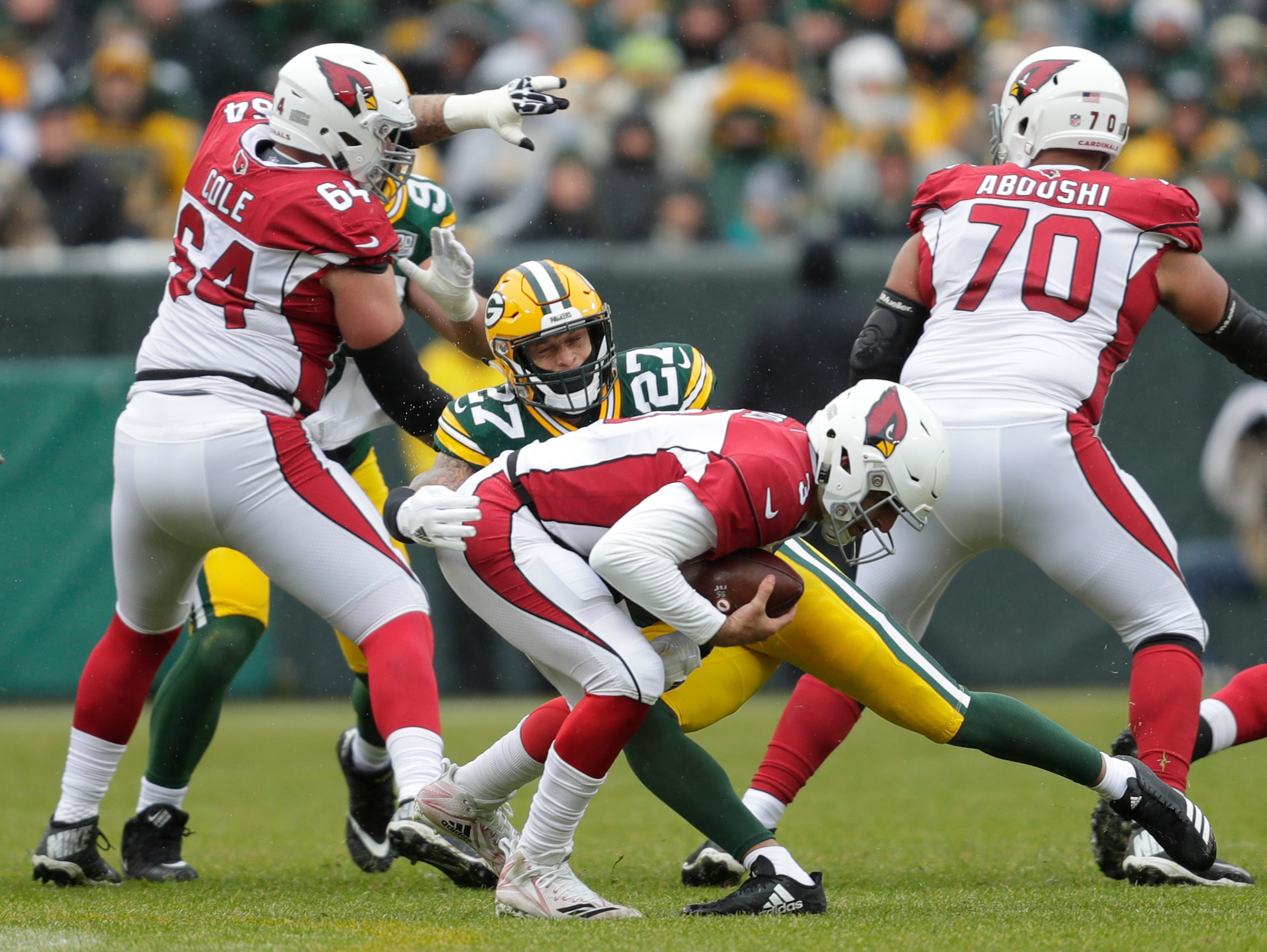 Green Bay Packers defensive back Josh Jones (27) sacks Arizona Cardinals quarterback Josh Rosen (3) in the first quarter Sunday, December 2, 2018, at Lambeau Field in Green Bay, Wis.