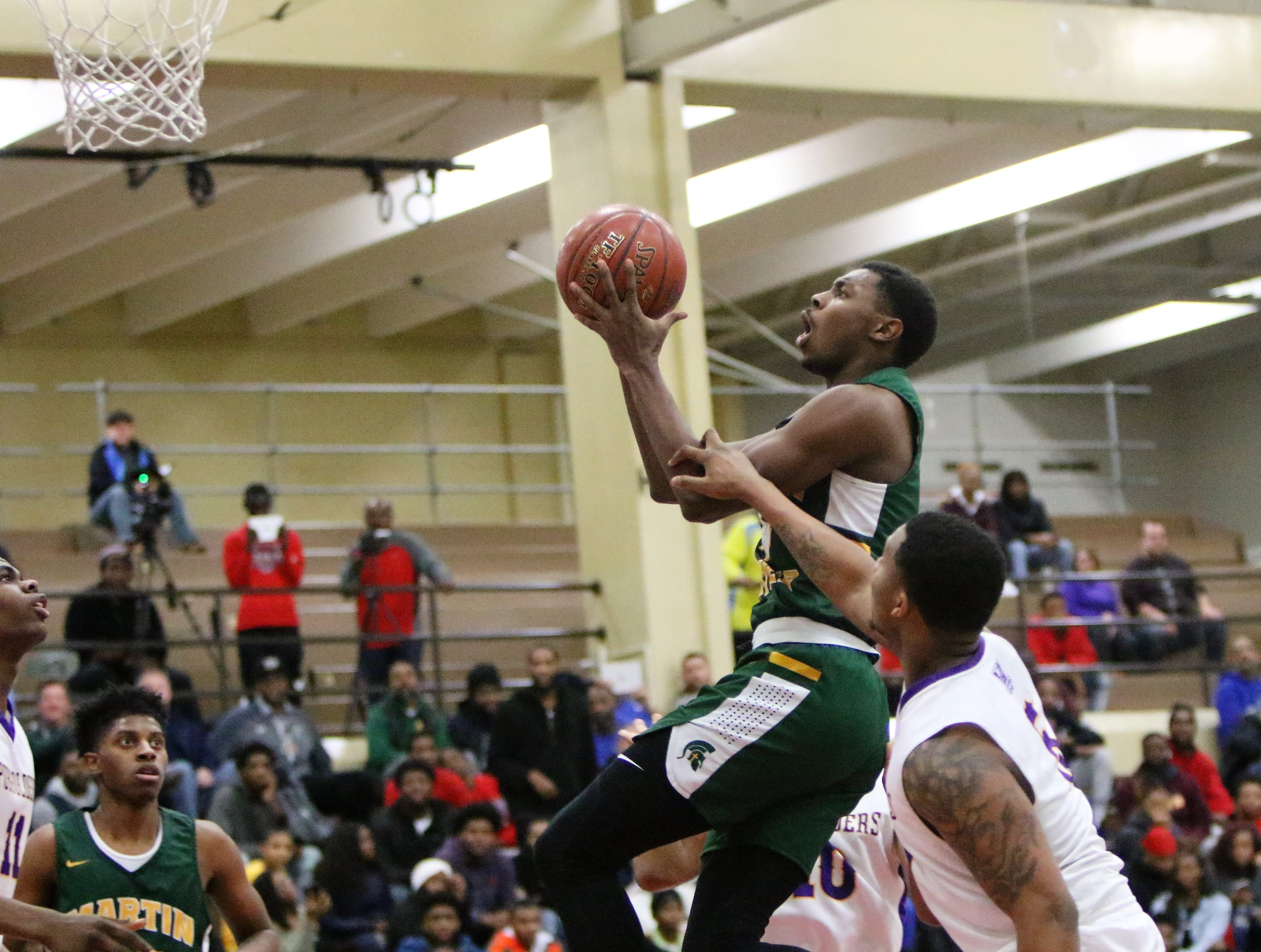 Martin Luther guard Xzavier Jones rises up for a layup against Milwaukee Washington during the Terry Porter Classic on Saturday.