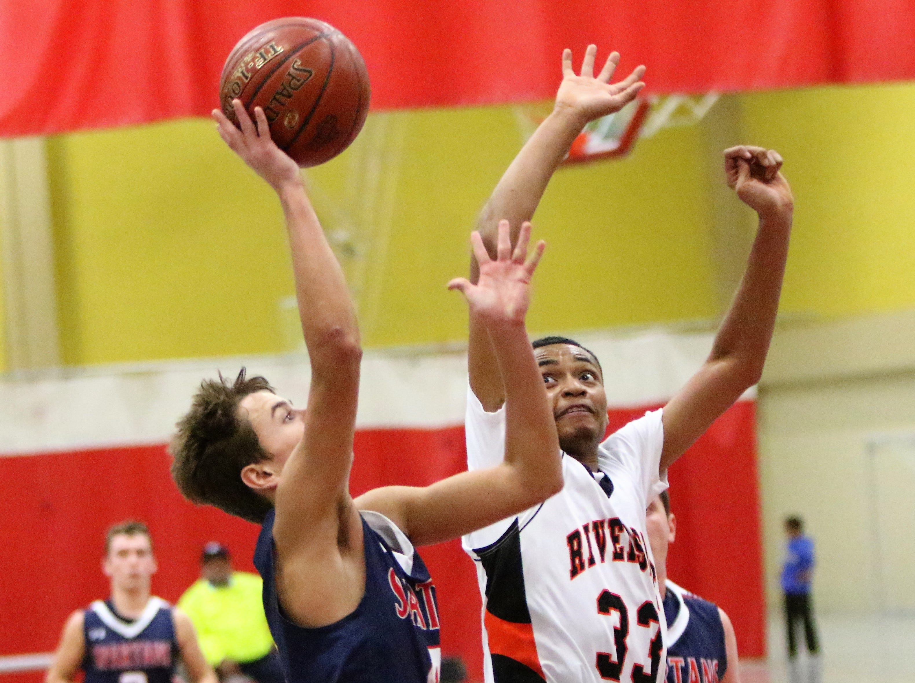 Milwaukee Riverside forward Deandre Algee rises up to block a shot against Brookfield East during the Terry Porter Classic on Saturday.