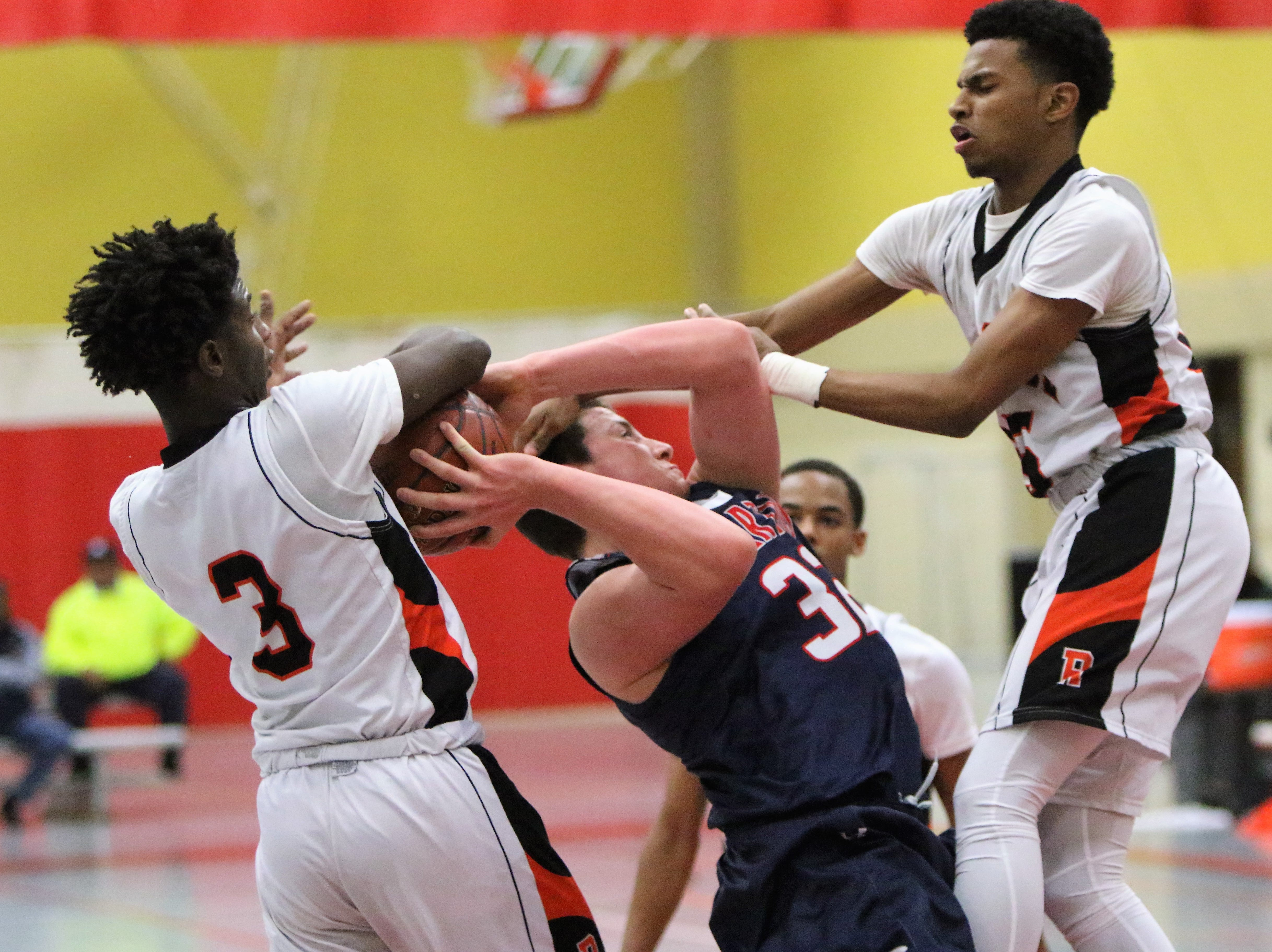 Brookfield East forward Riley LeTourneau is fouled by Milwaukee Riverside defenders during the Terry Porter Classic on Saturday.