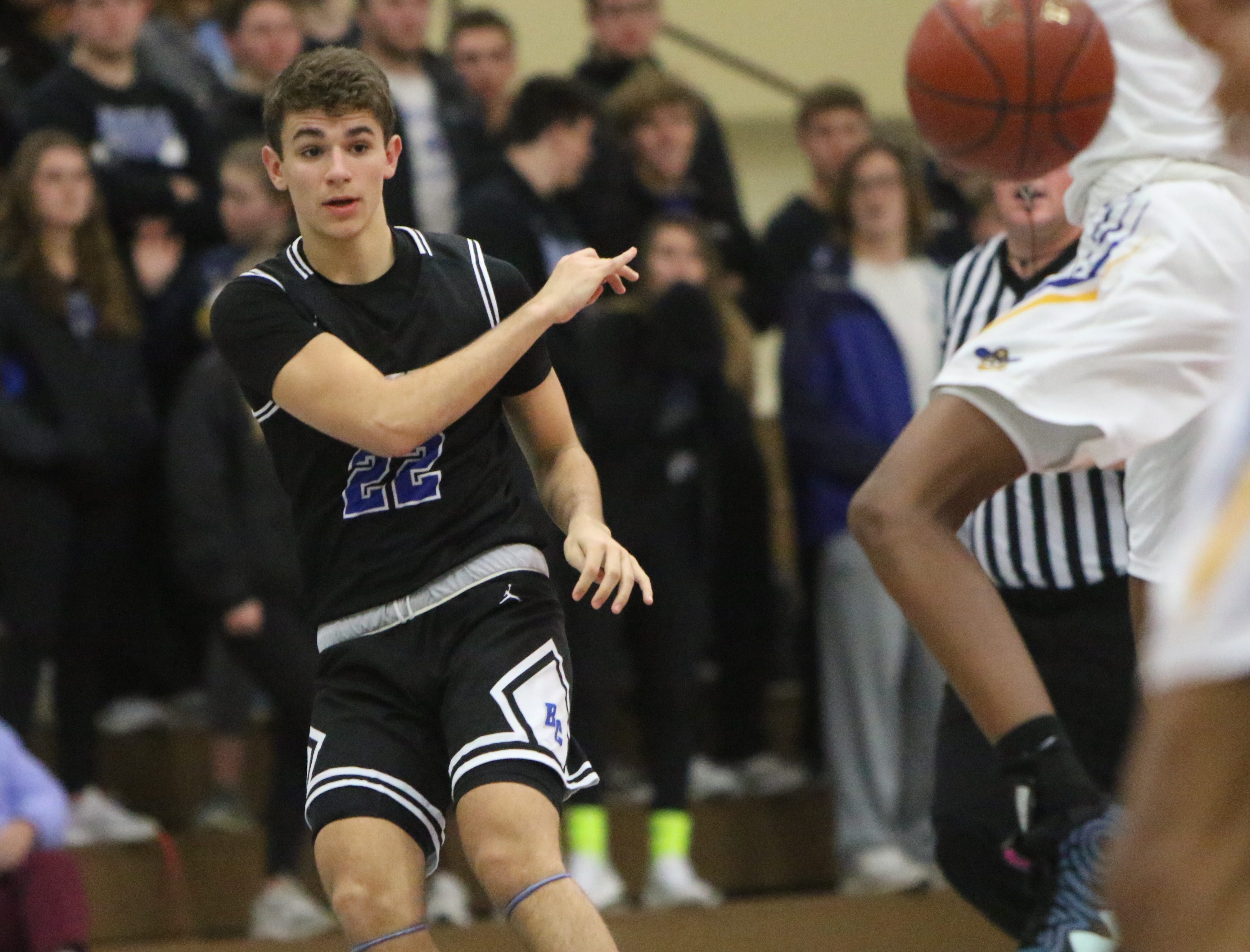 Brookfield Central guard Ben Nau whips a pass up the court against Milwaukee King during the Terry Porter Classic on Saturday.